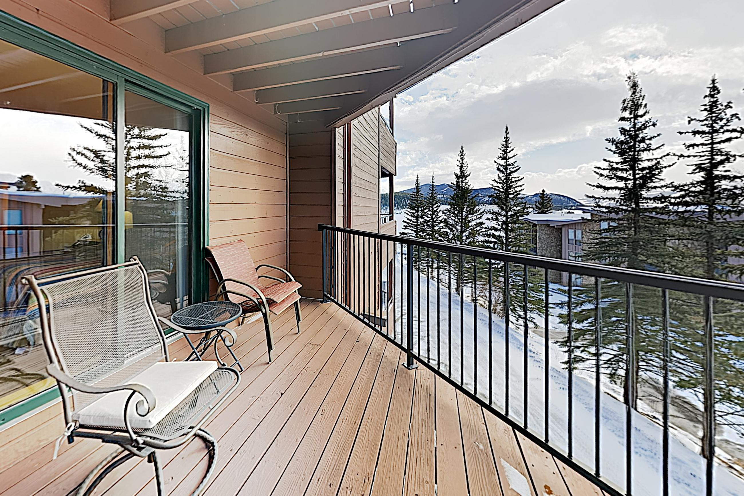 Enjoy lake and mountain views from the covered private balcony.