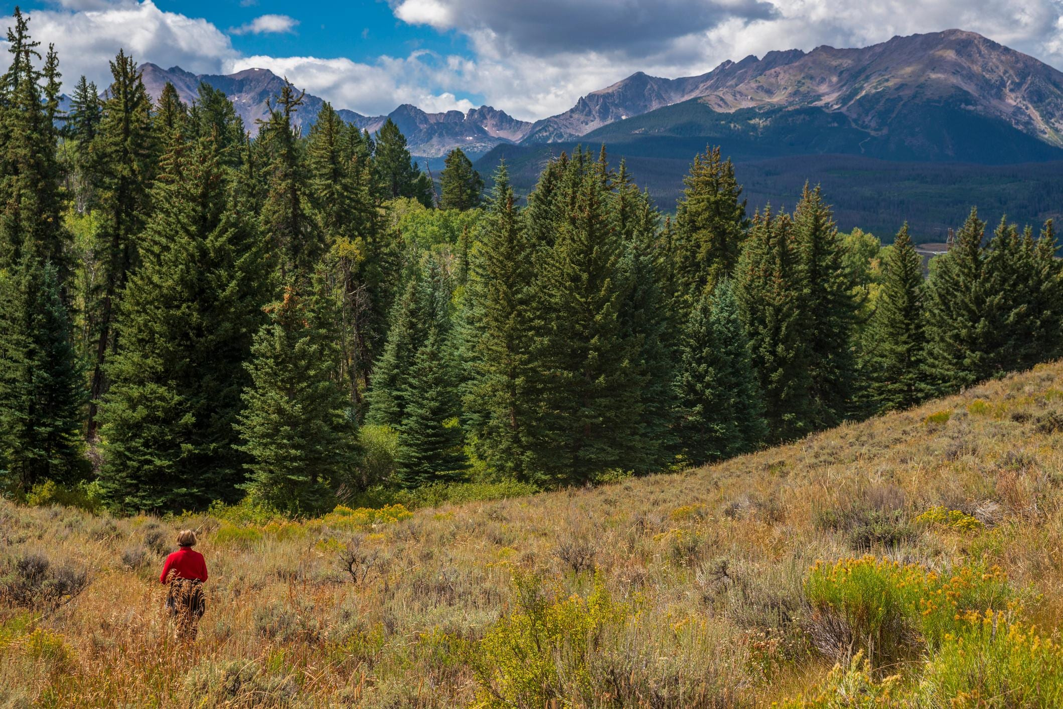 Go hiking in the fall in the Rocky Mountains.