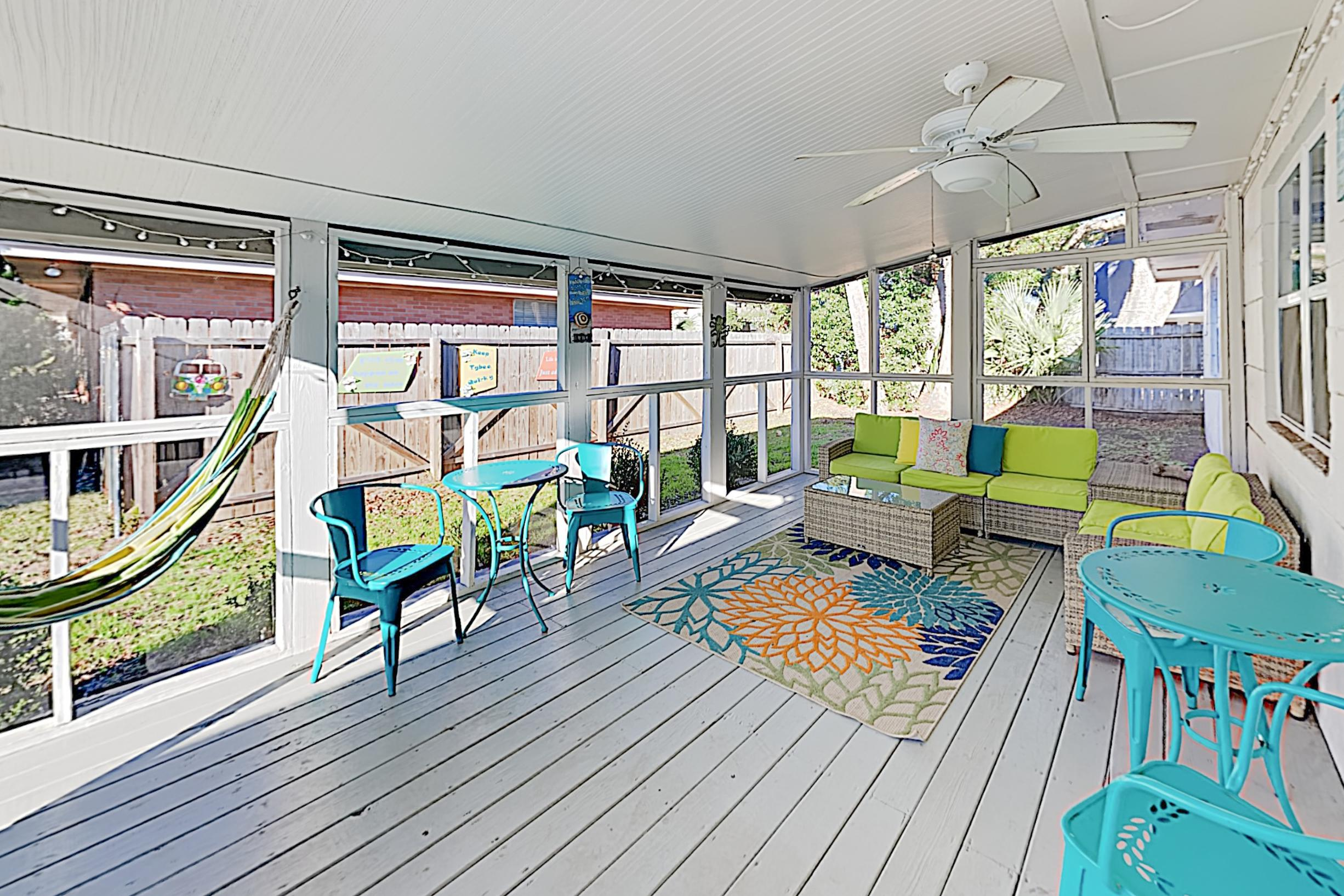 Spend leisurely afternoons on your screened porch.