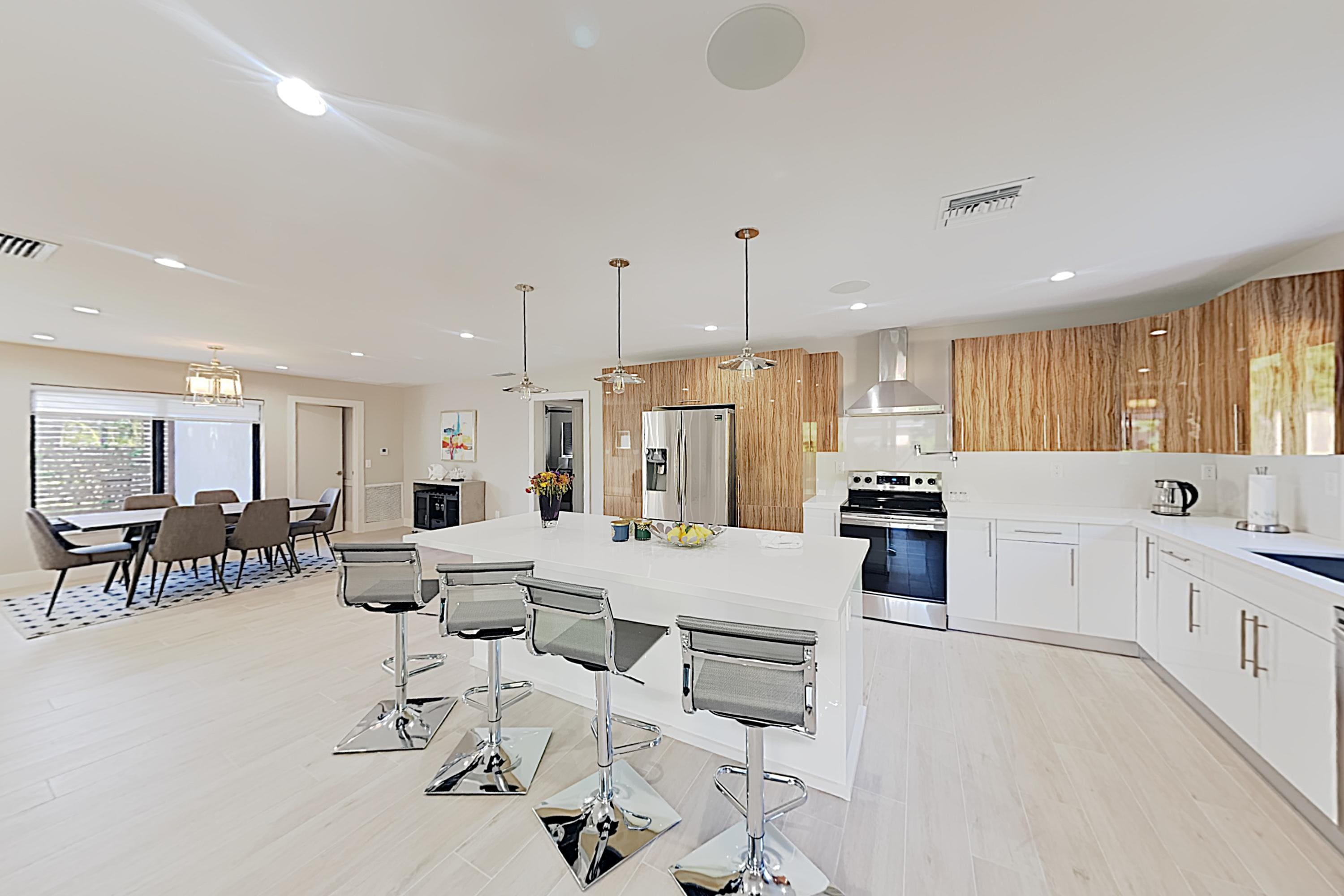 The expansive center island in the kitchen seats 4.