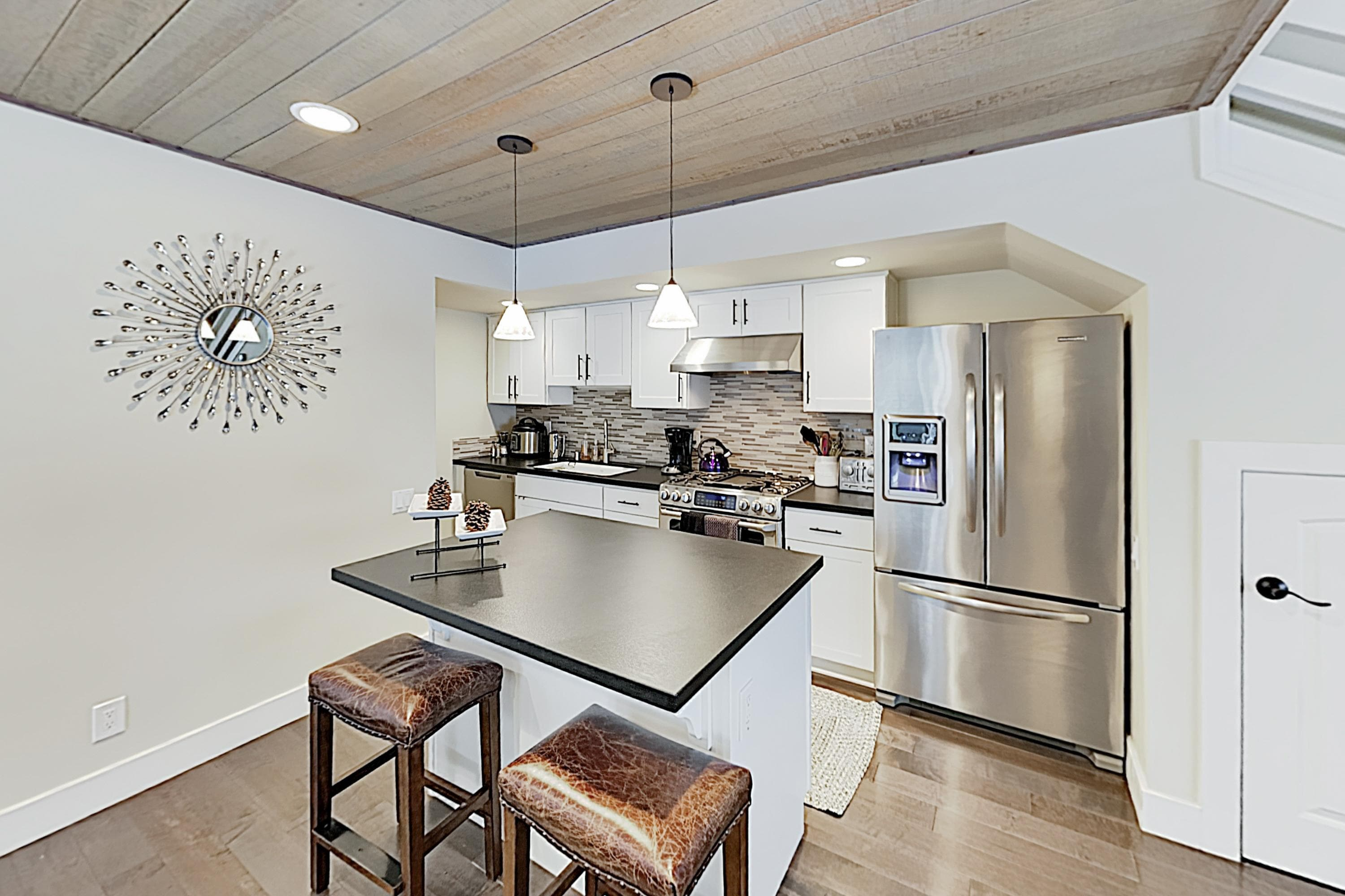 Whip up delectable creations in the well-appointed kitchen, equipped with a full suite of stainless steel appliances.