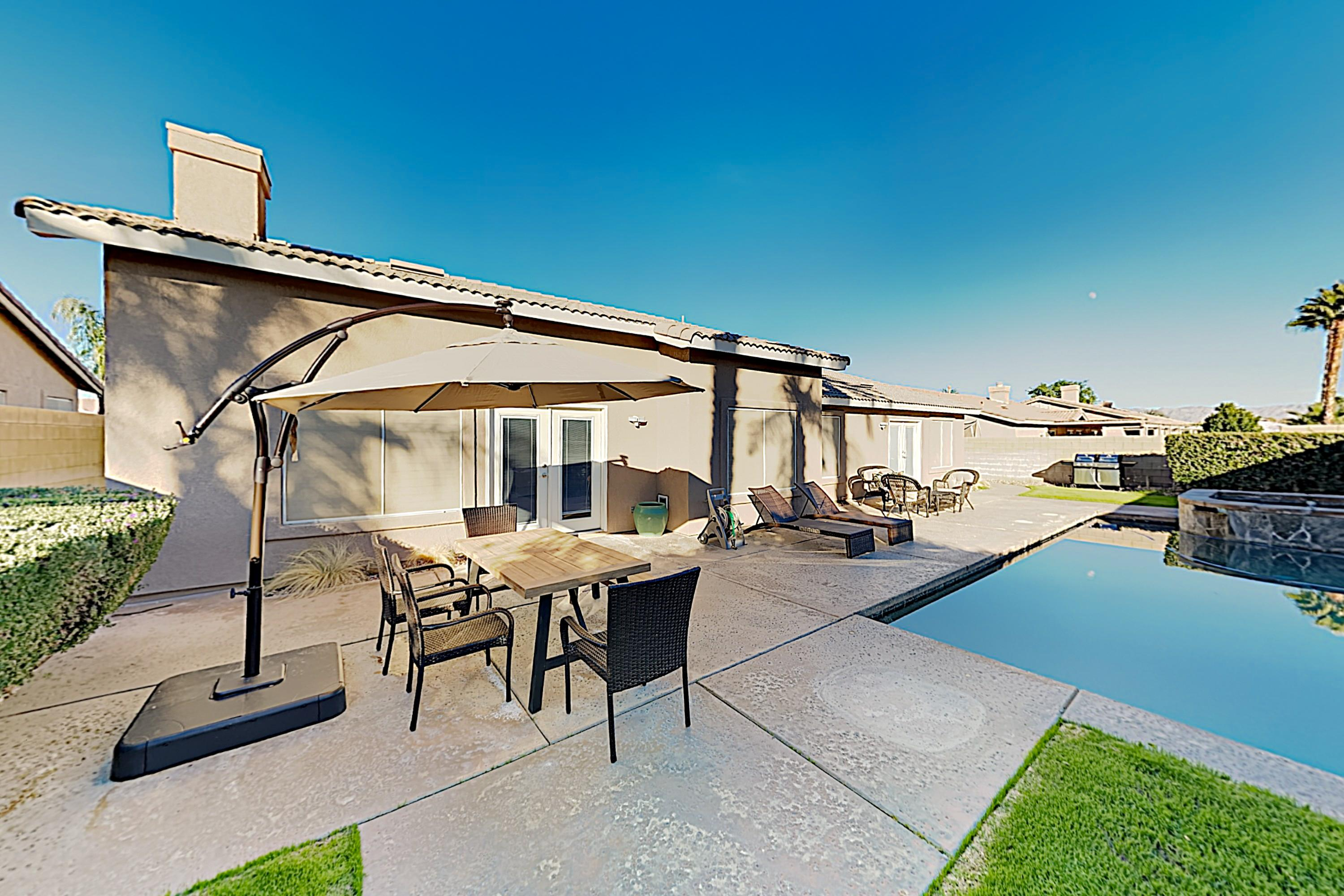 A private south-facing backyard boasts a heated saltwater pool and hot tub!