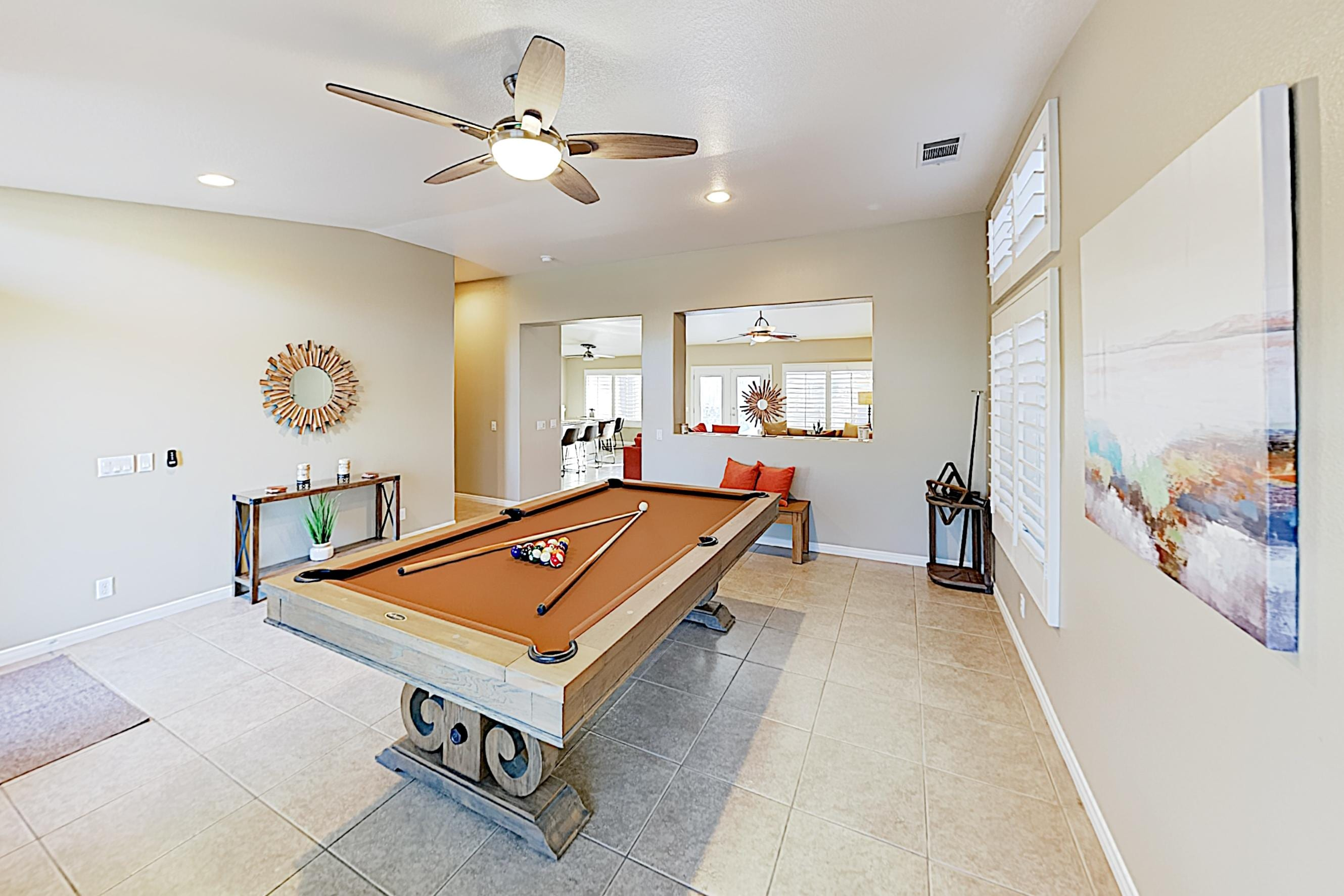 Rack up a full-size pool table in the stylish game room.