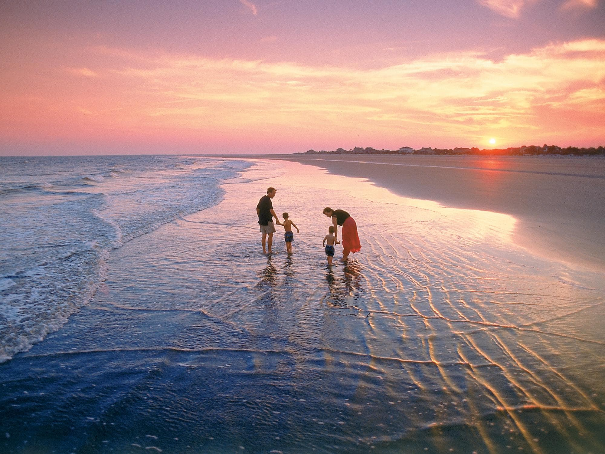 Walk along nearby pristine beaches and take in beautiful sunset views.