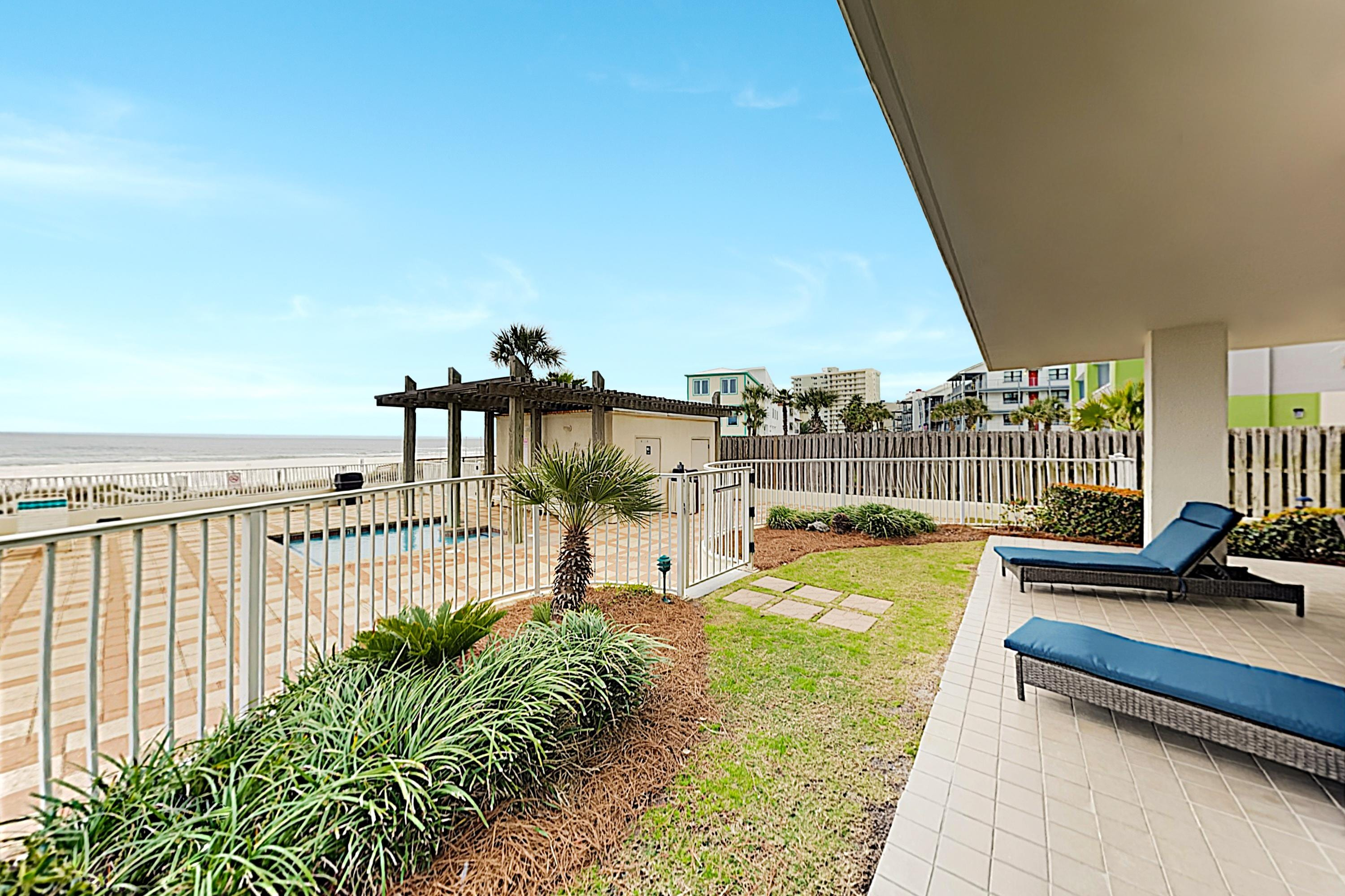 Enjoy the ocean breeze from comfortable loungers on your private patio.