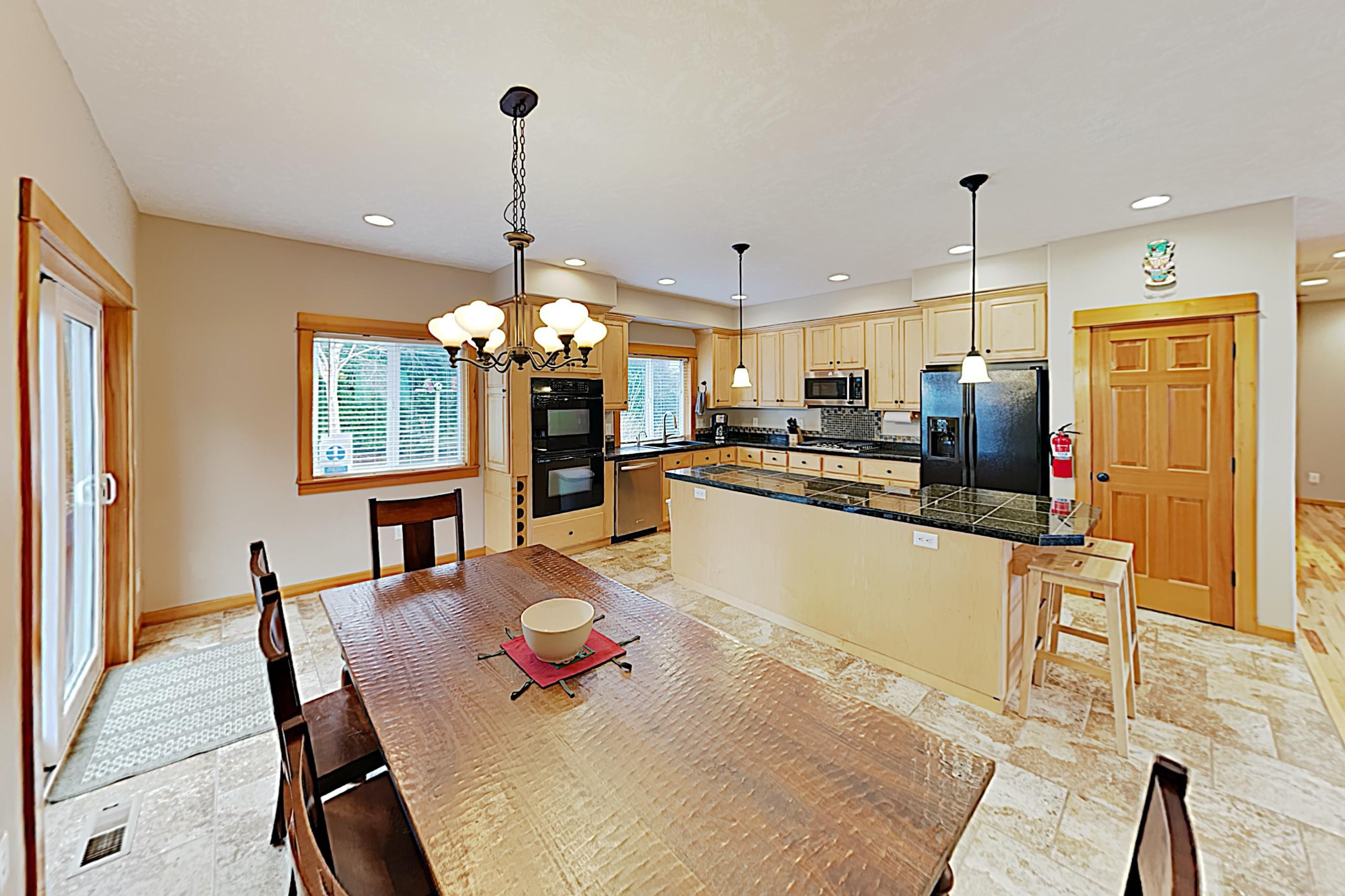 The open kitchen and dining space offers a great flow for entertaining.