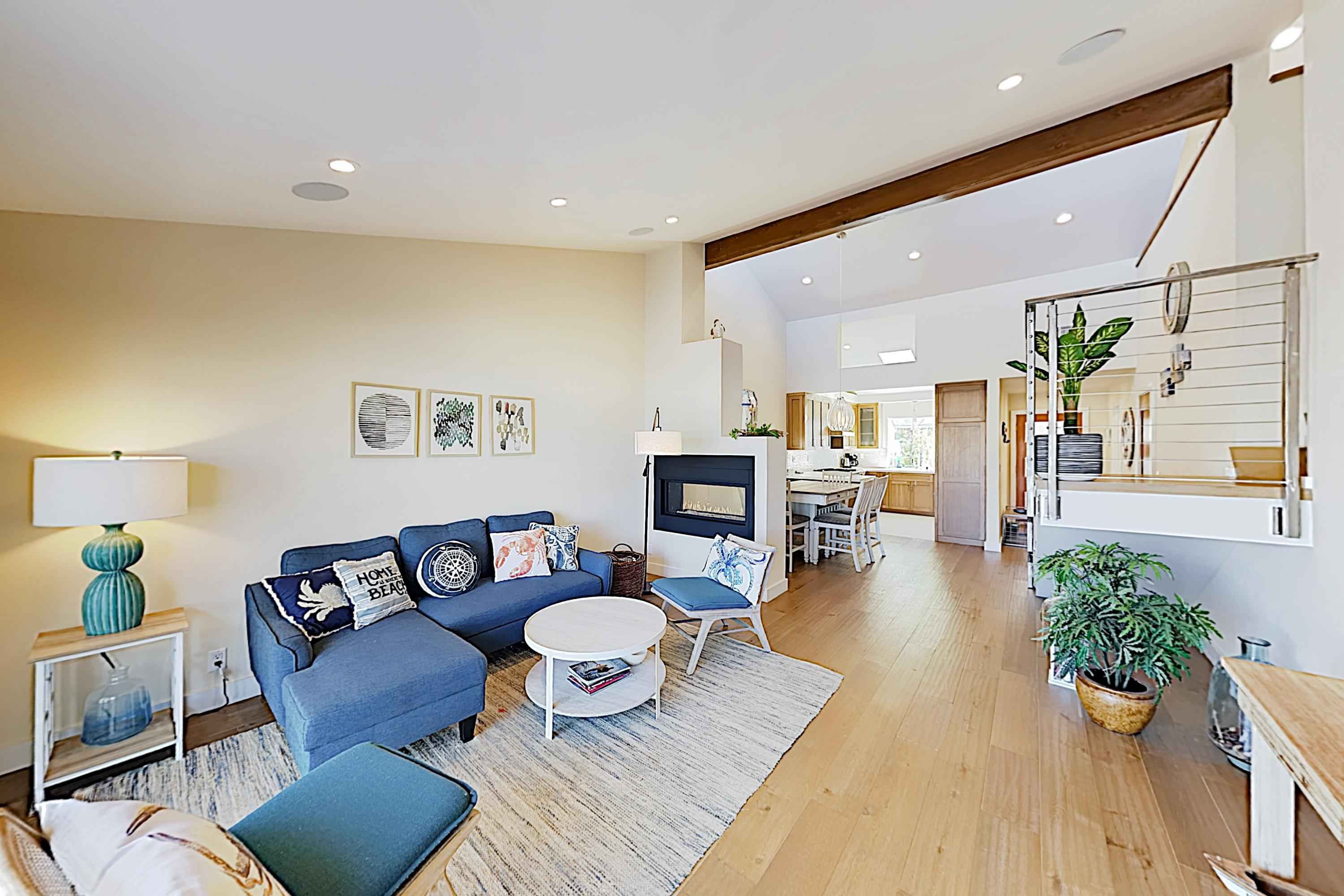 The bright interior features oak floors and a double-sided gas fireplace.