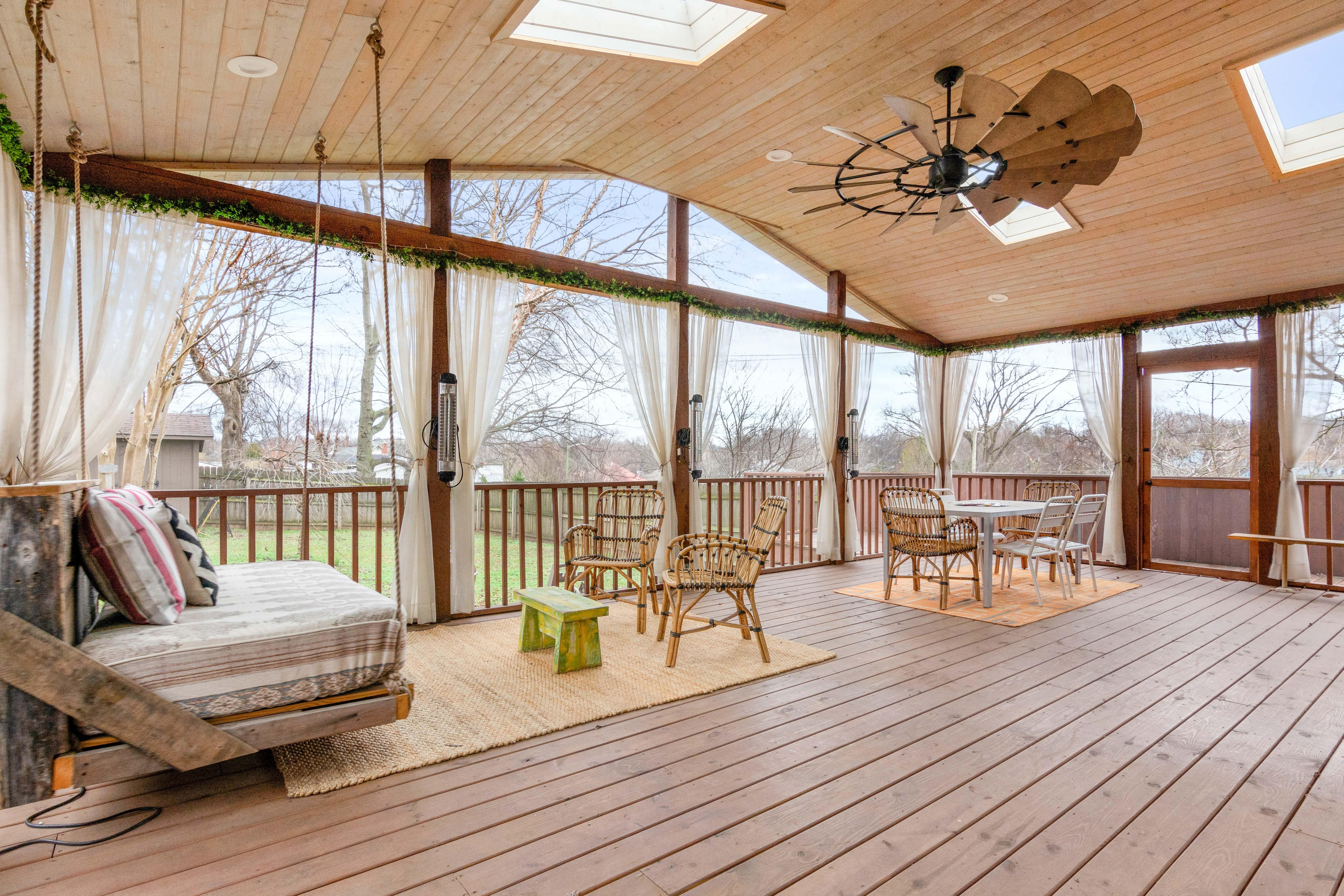The screened veranda offers a serene retreat on sunny Tennessee days.
