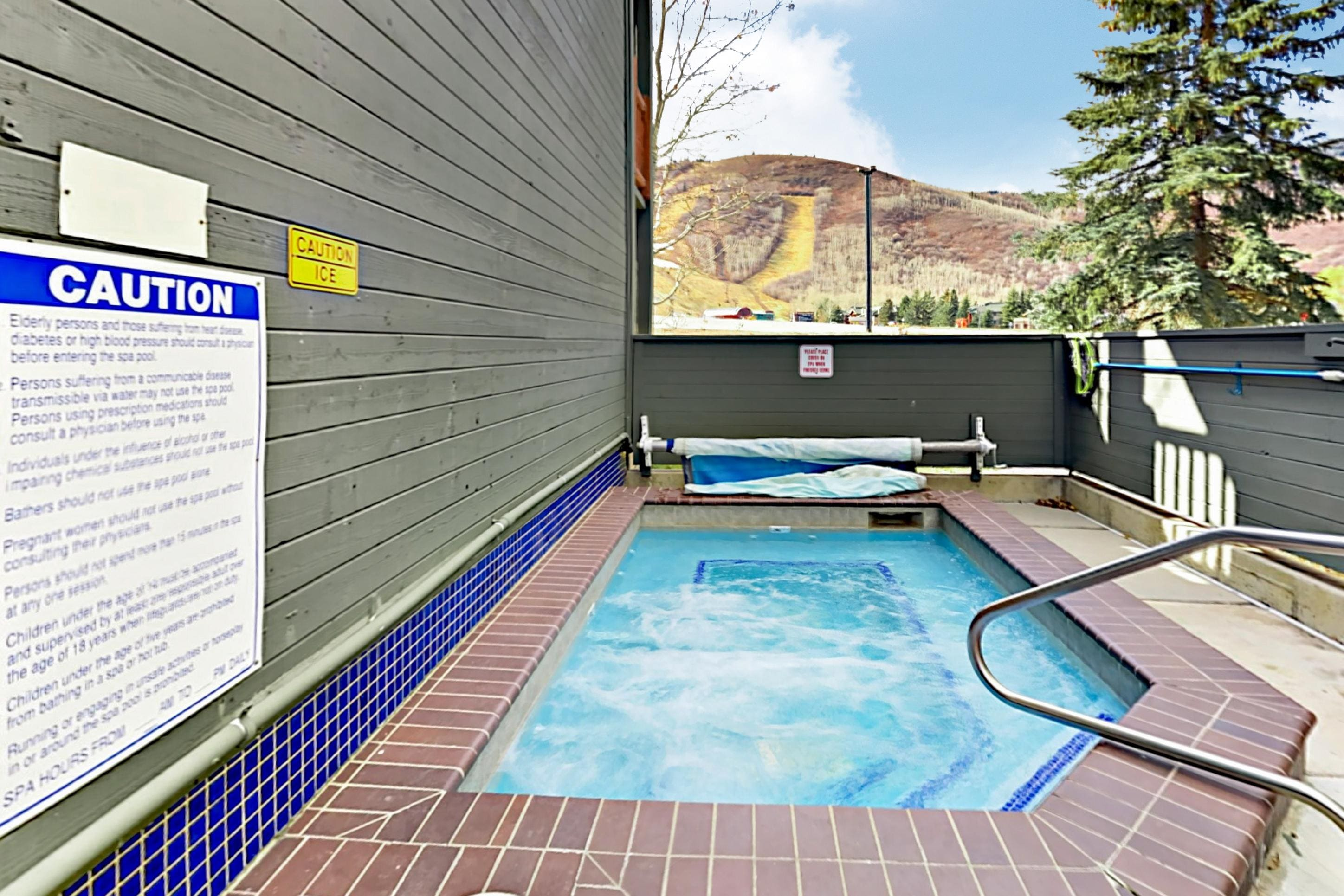 Relax in the bubbling hot tub with mountain views.