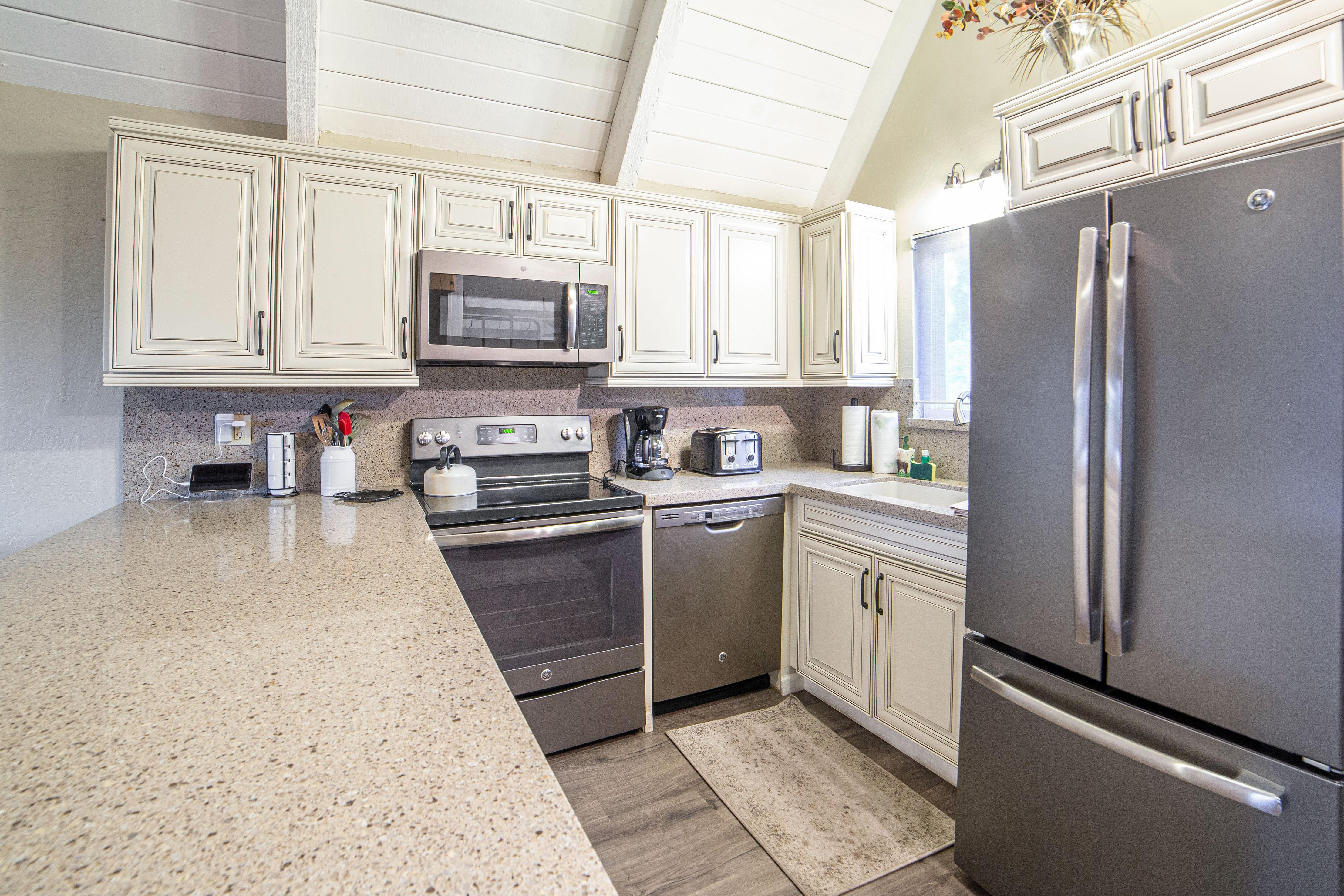 Stainless steel appliances shine in the remodeled gourmet kitchen.