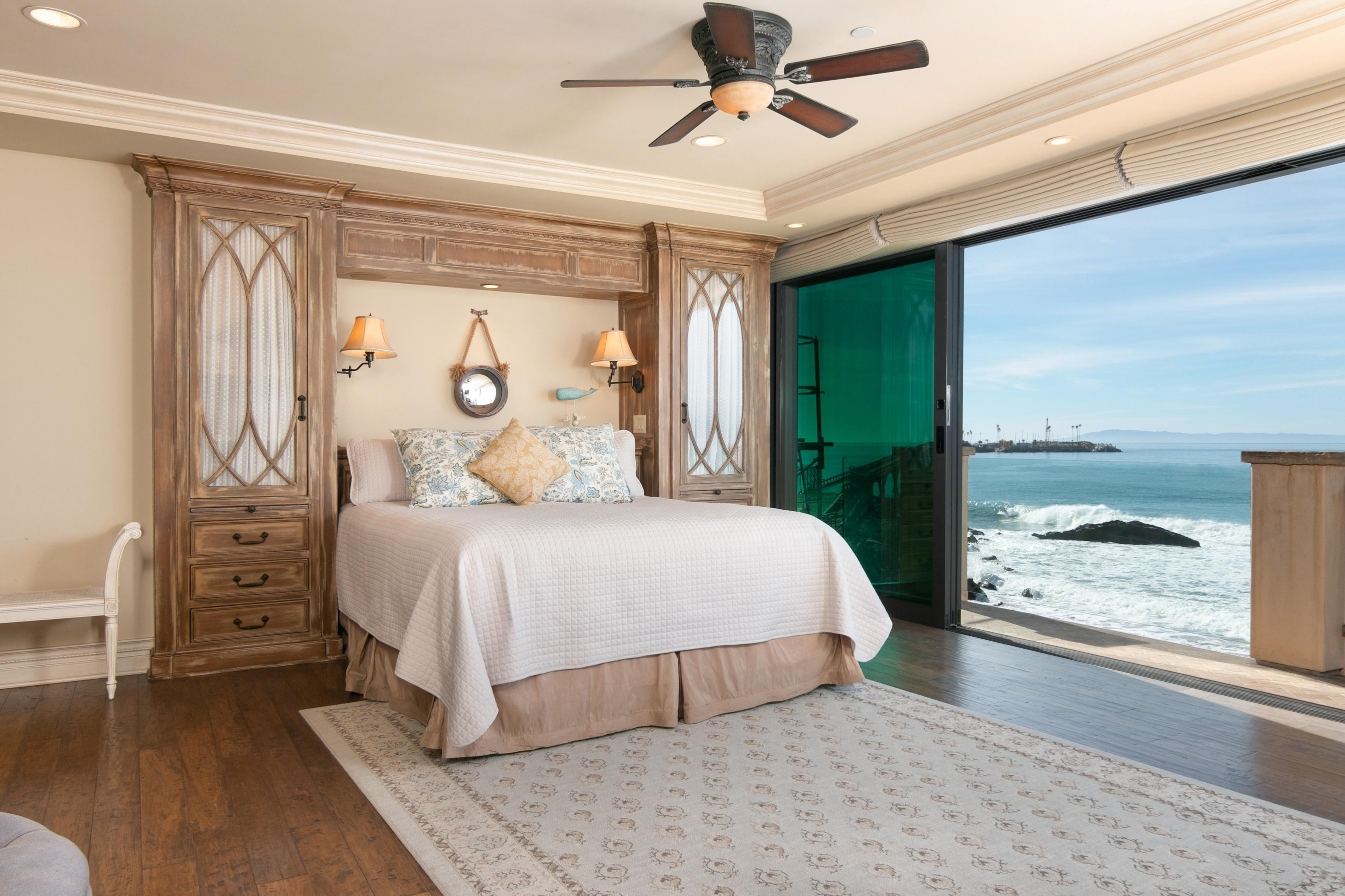 With a retractable glass wall leading to a private balcony, the master suite offers a truly extraordinary retreat.