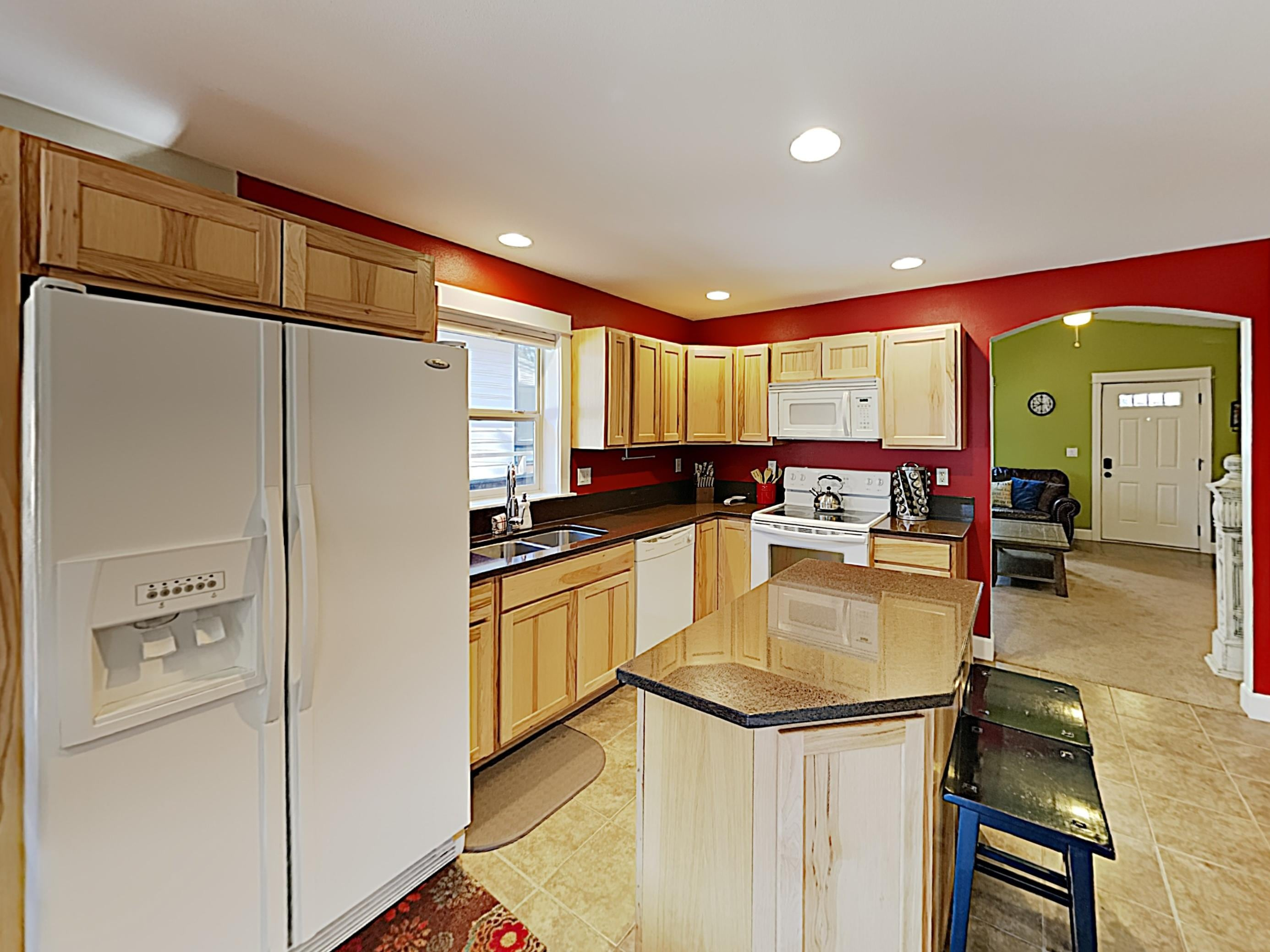 The kitchen is appointed with a full suite of appliances and plenty of cookware.
