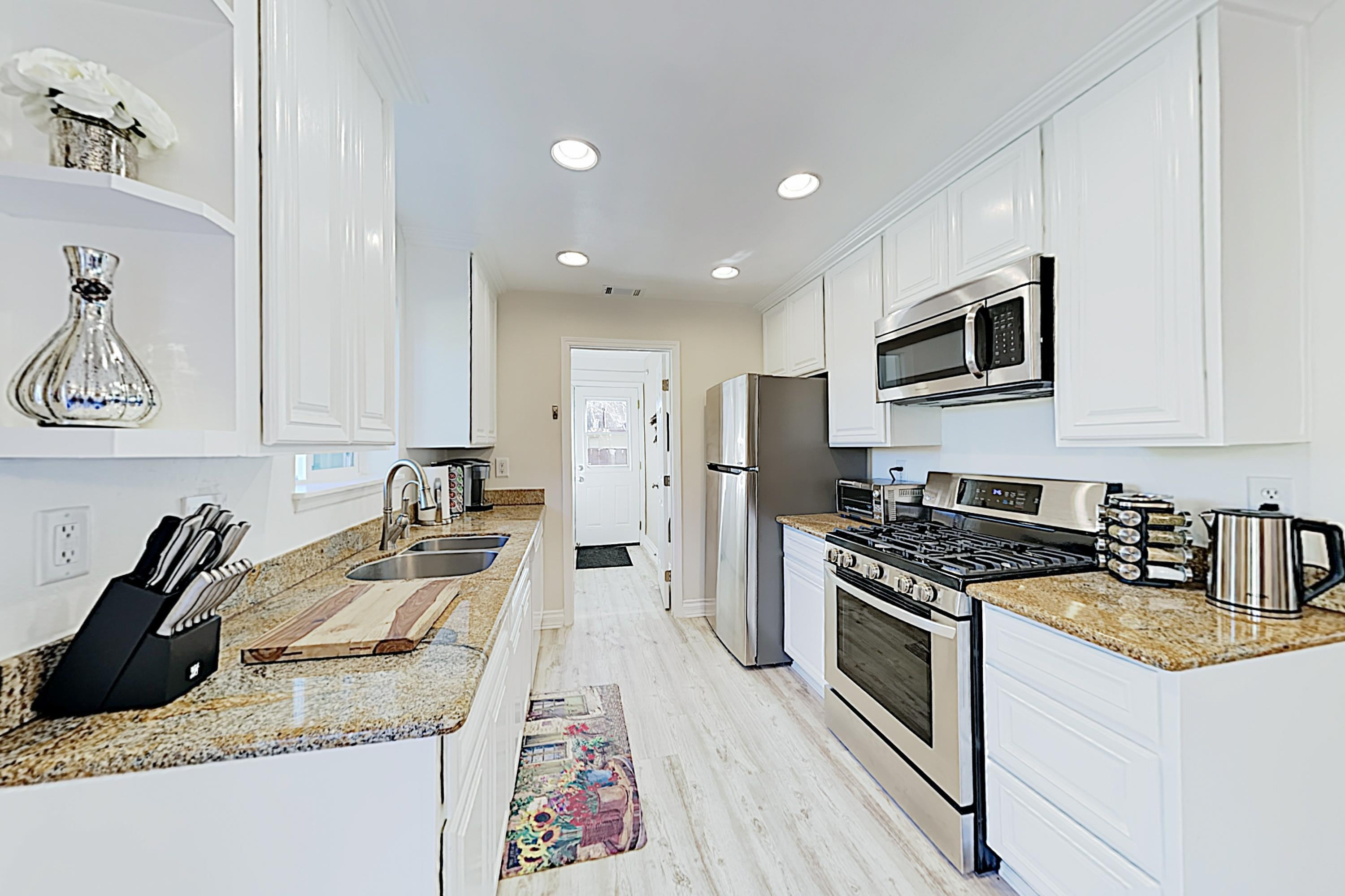 The upscale kitchen offers a full suite of stainless steel appliances.