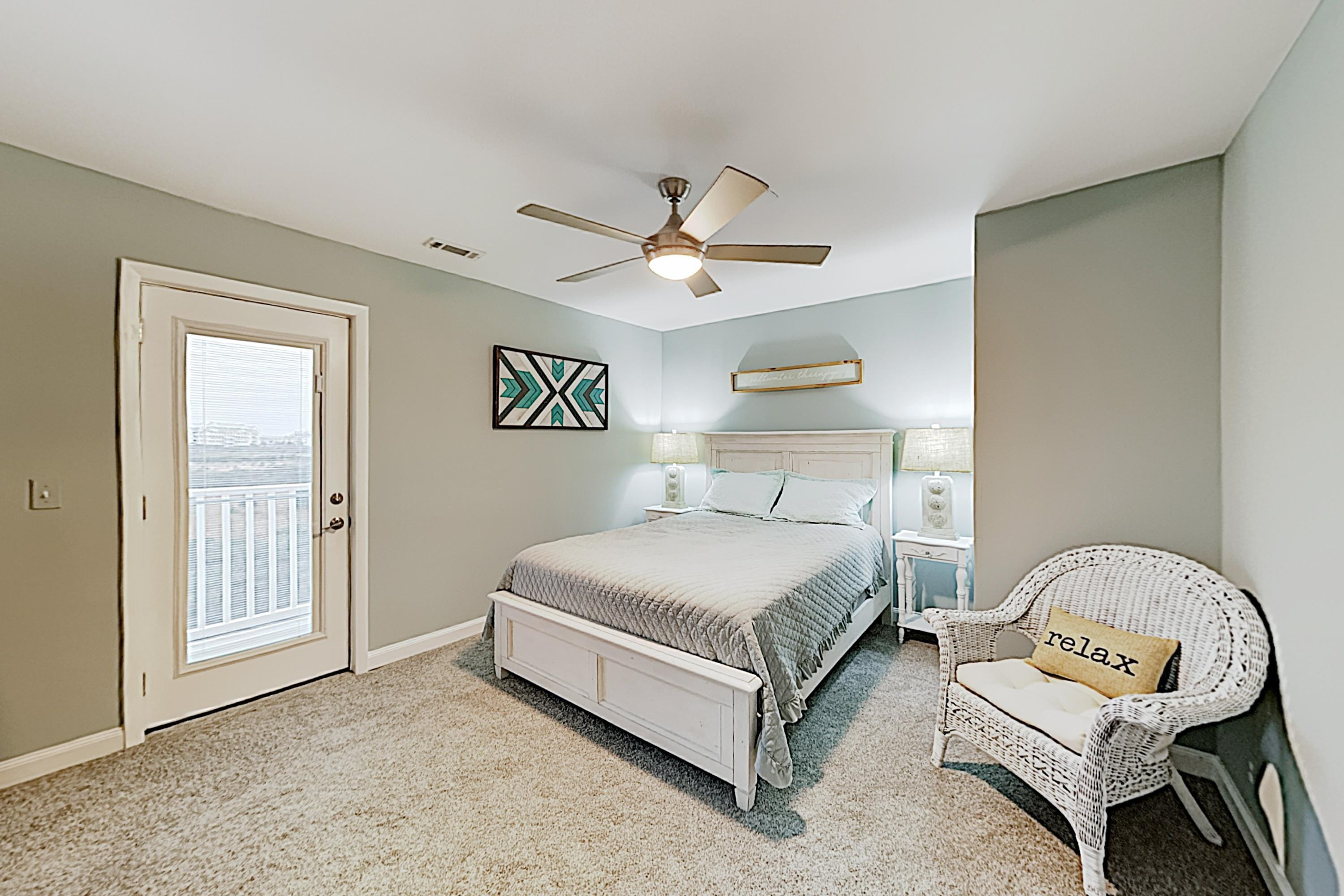 Sleep soundly in the master bedroom, furnished with a comfortable queen bed.