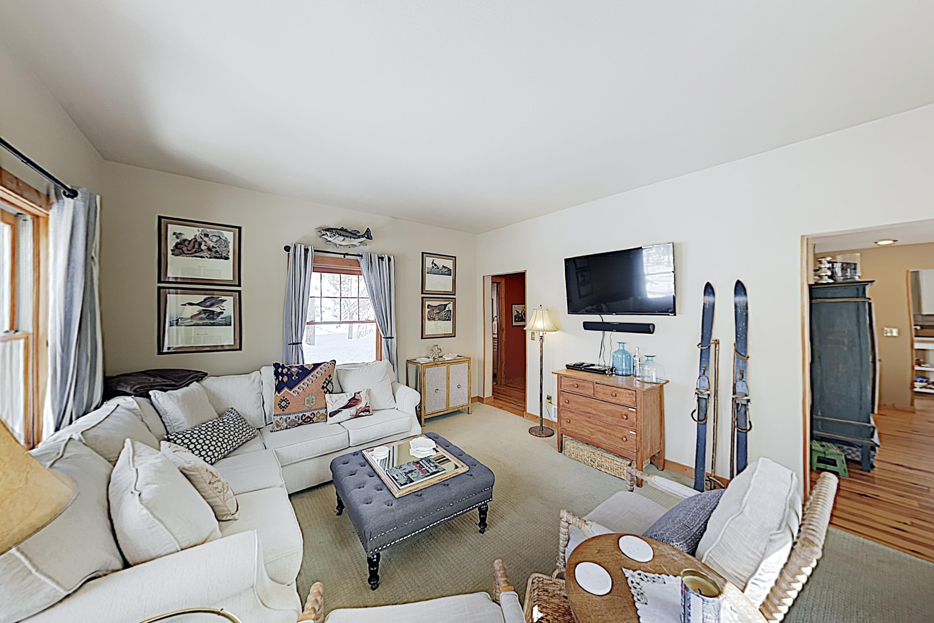 Relax in the stylish 2nd living area, furnished with a plush sectional and 2 chairs.