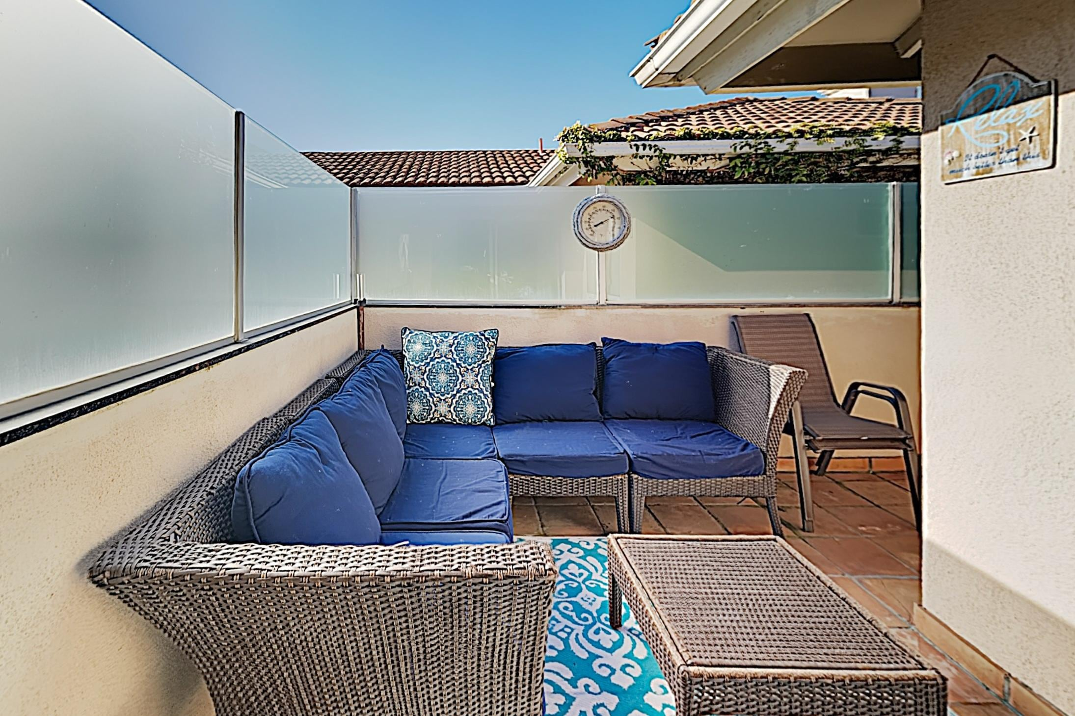 Enjoy the fresh air in a comfy lounge area on the balcony.