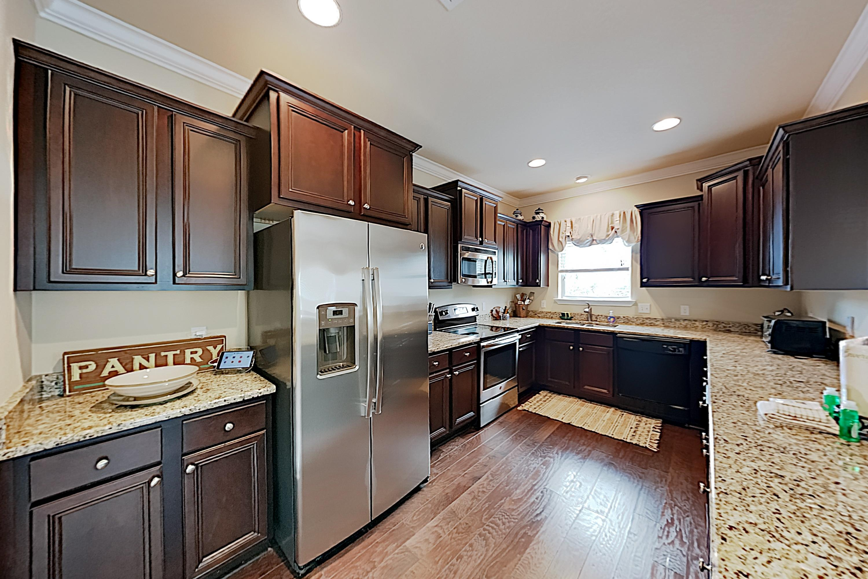 The sparkling kitchen is equipped with a full suite of stainless steel appliances.