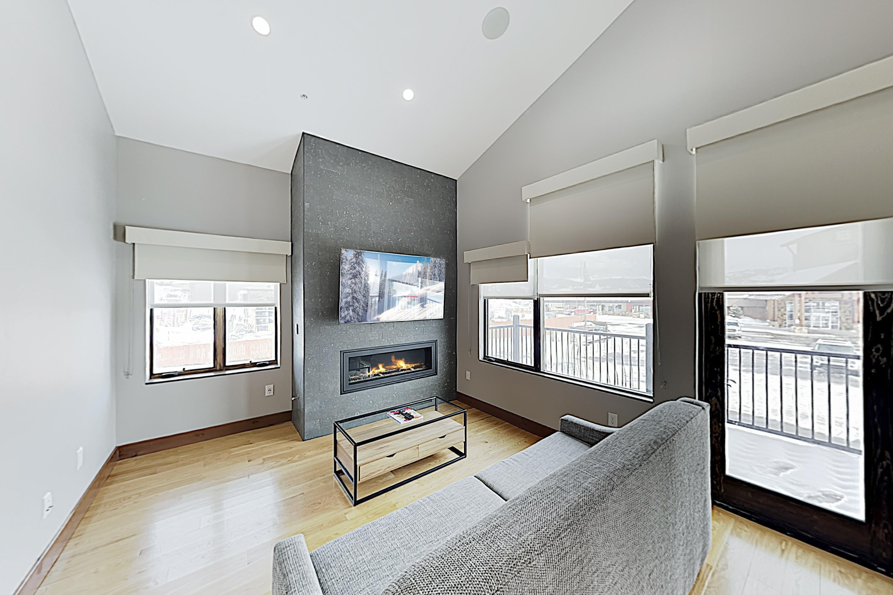 "Cozy up in front of the gas fireplace and watch a movie on the 65"" smart TV in the living area."