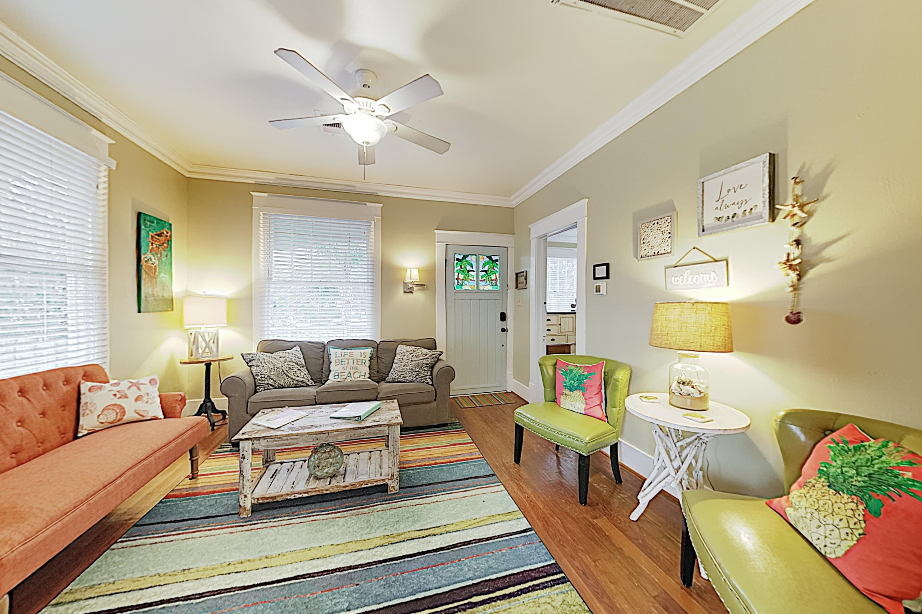 The living room is furnished with a sleeper sofa, love seat, and 2 chairs.