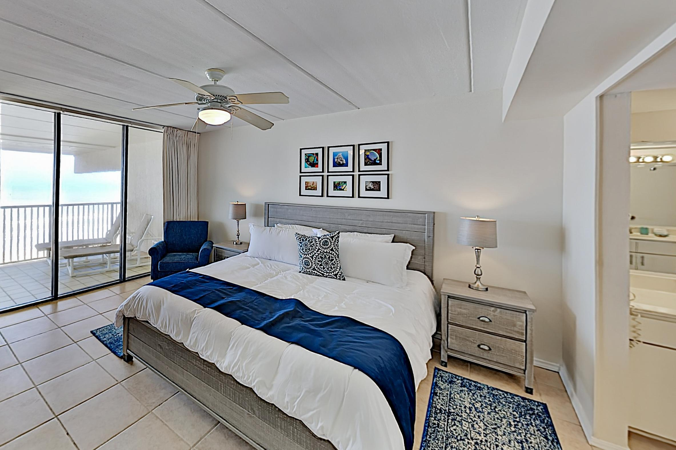 Rest easy in the master bedroom, furnished with a comfortable king bed.