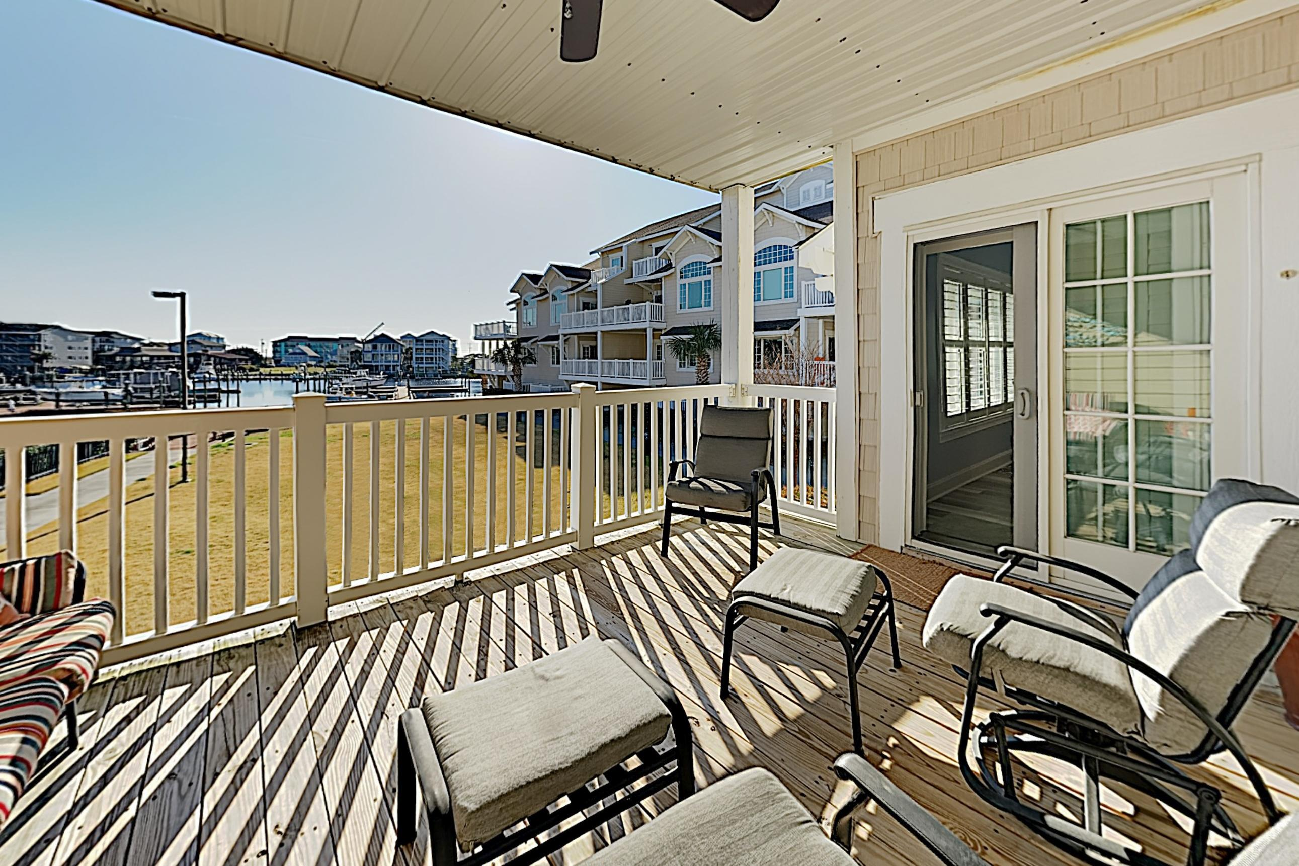 Serene Condo with Water-View Balcony & Shared Pool; Walk to Beach
