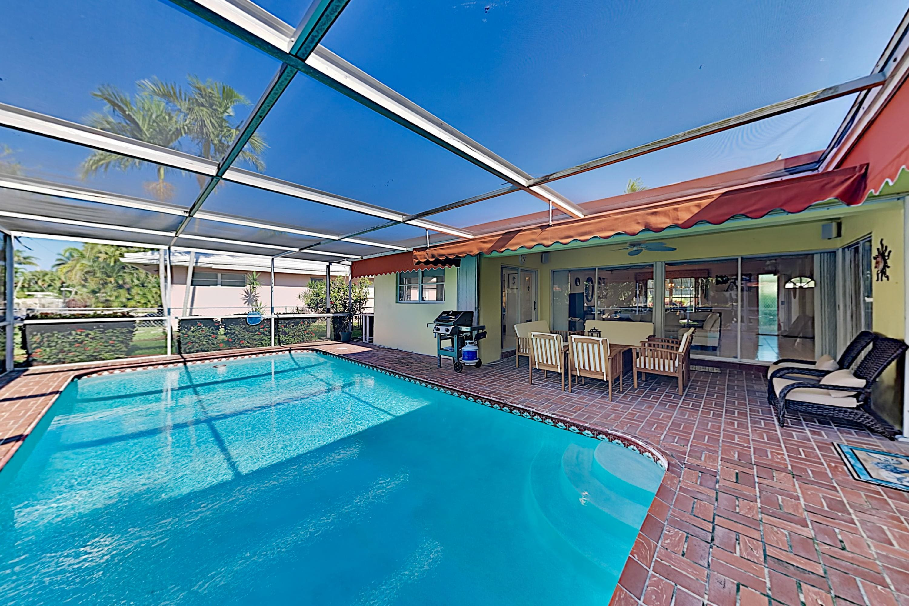 Property Image 1 - Waterfront Home with Screened-in Heated Pool & Lanai