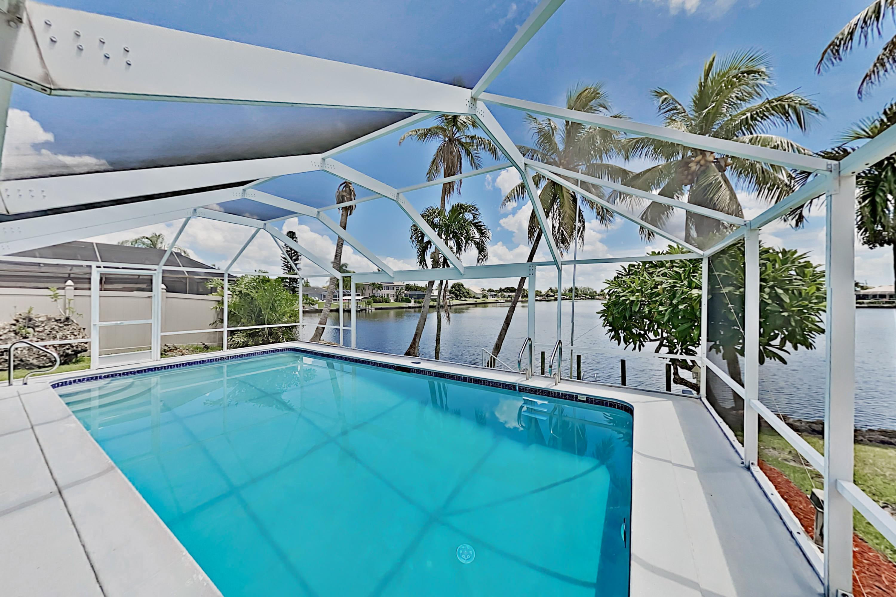 Property Image 1 - Luxe Waterfront Home with Screened Pool & Private Dock
