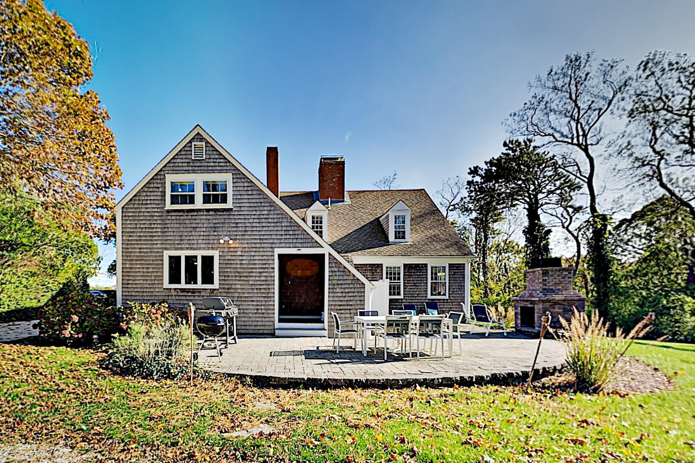 Classic Cape Cod Home | Patio & Outdoor Fireplace