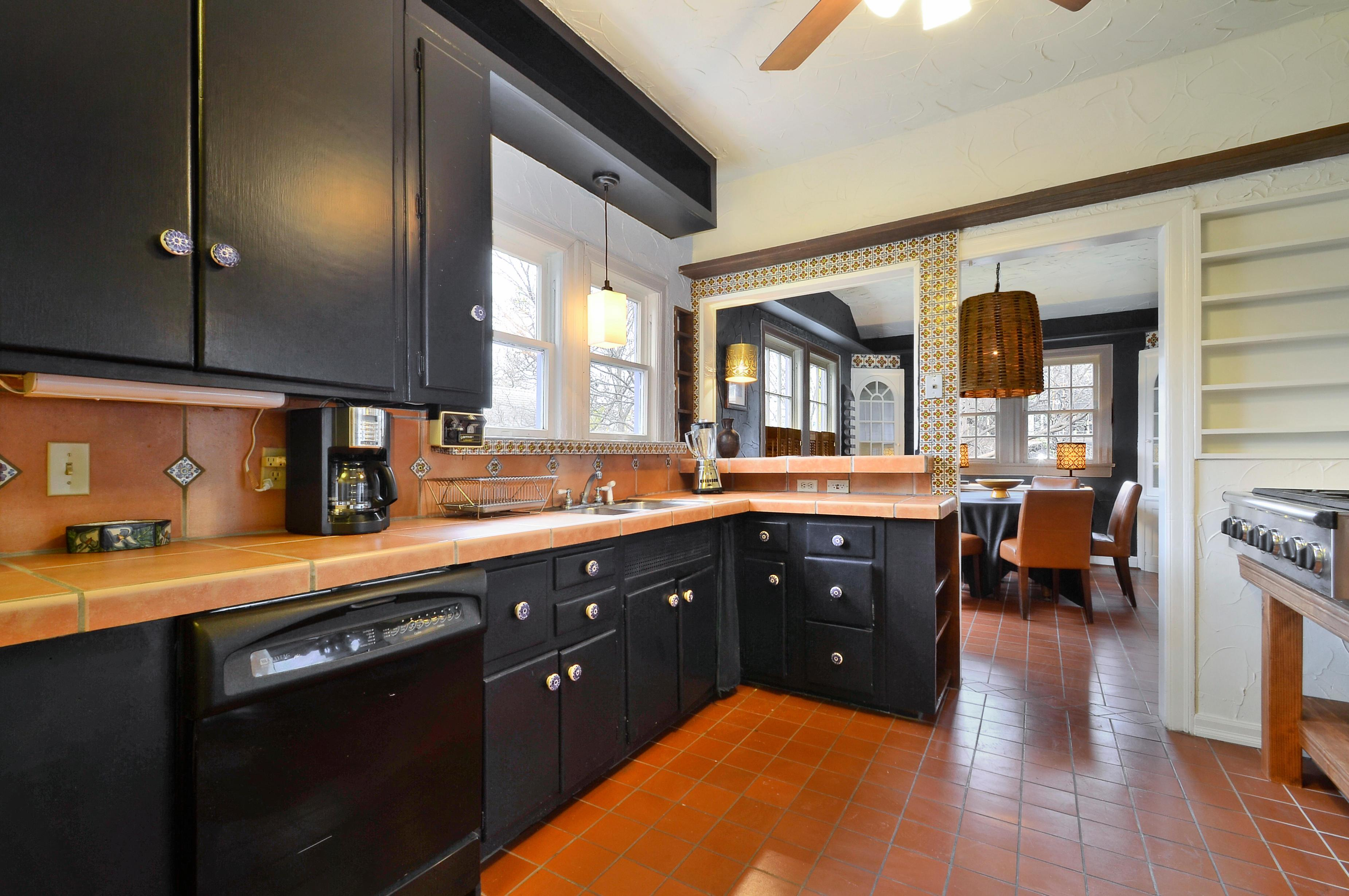 The fully equipped kitchen has a full suite of appliances, including a six-burner gas stove and a double oven.