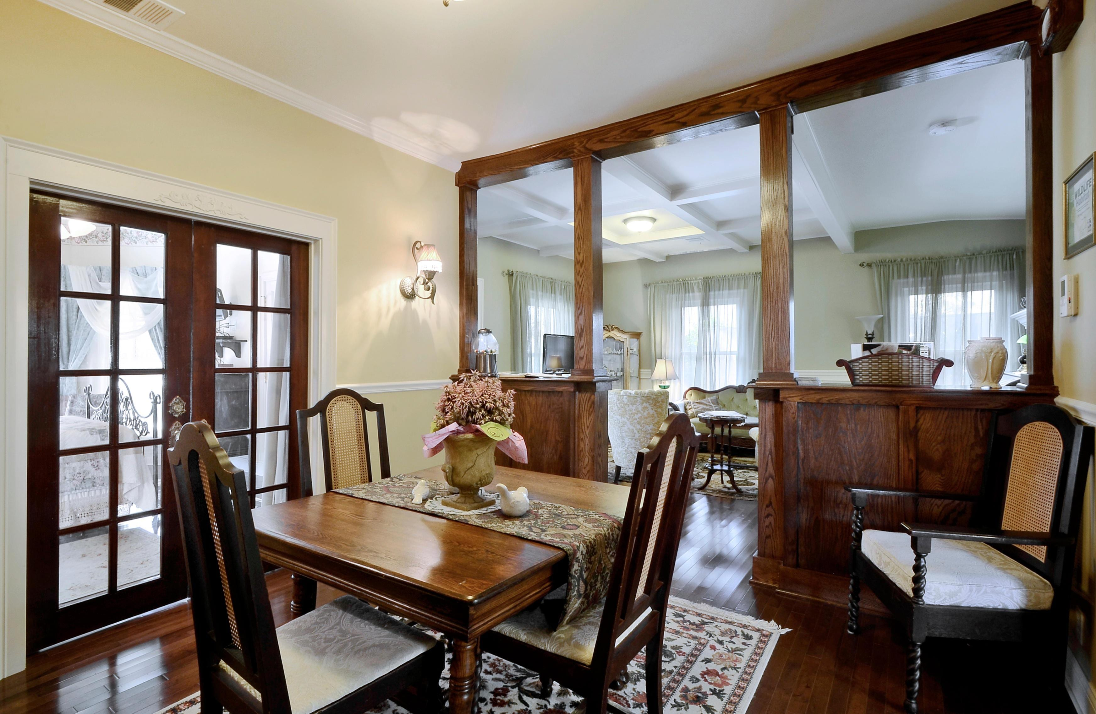The dining room table is a beautiful antique.
