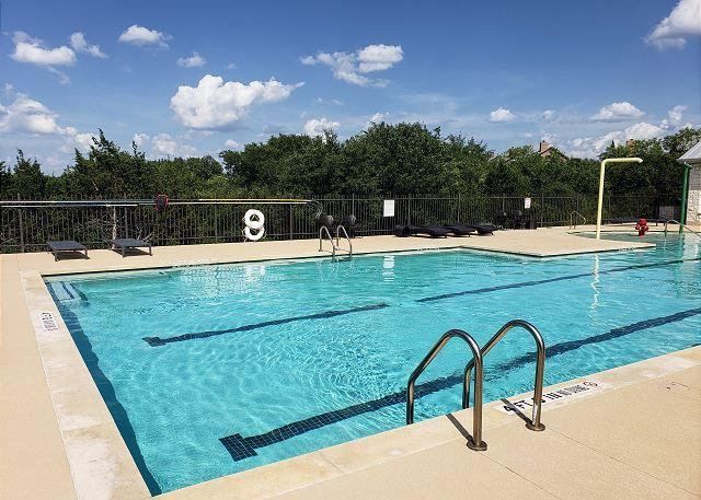 Lay out and soak up the sunshine by the lap pool in the community.