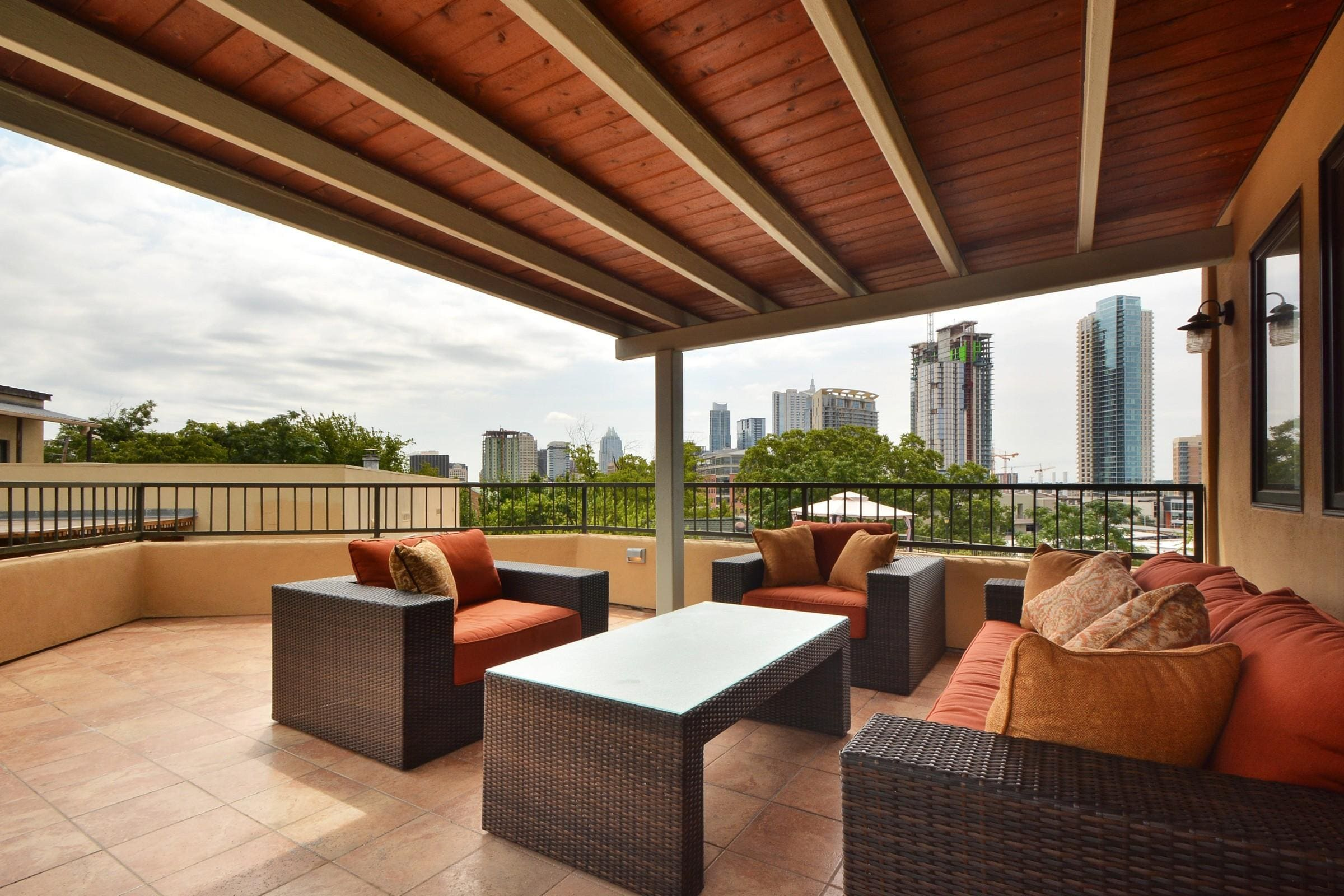 Up the stairs from the main floor, you'll discover an amazing deck and lounge area overlooking downtown Austin.