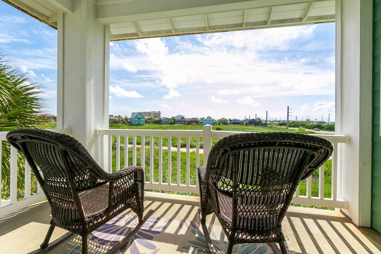Welcome to Port Aransas! Sip a crisp beverage and relax on the covered balcony.