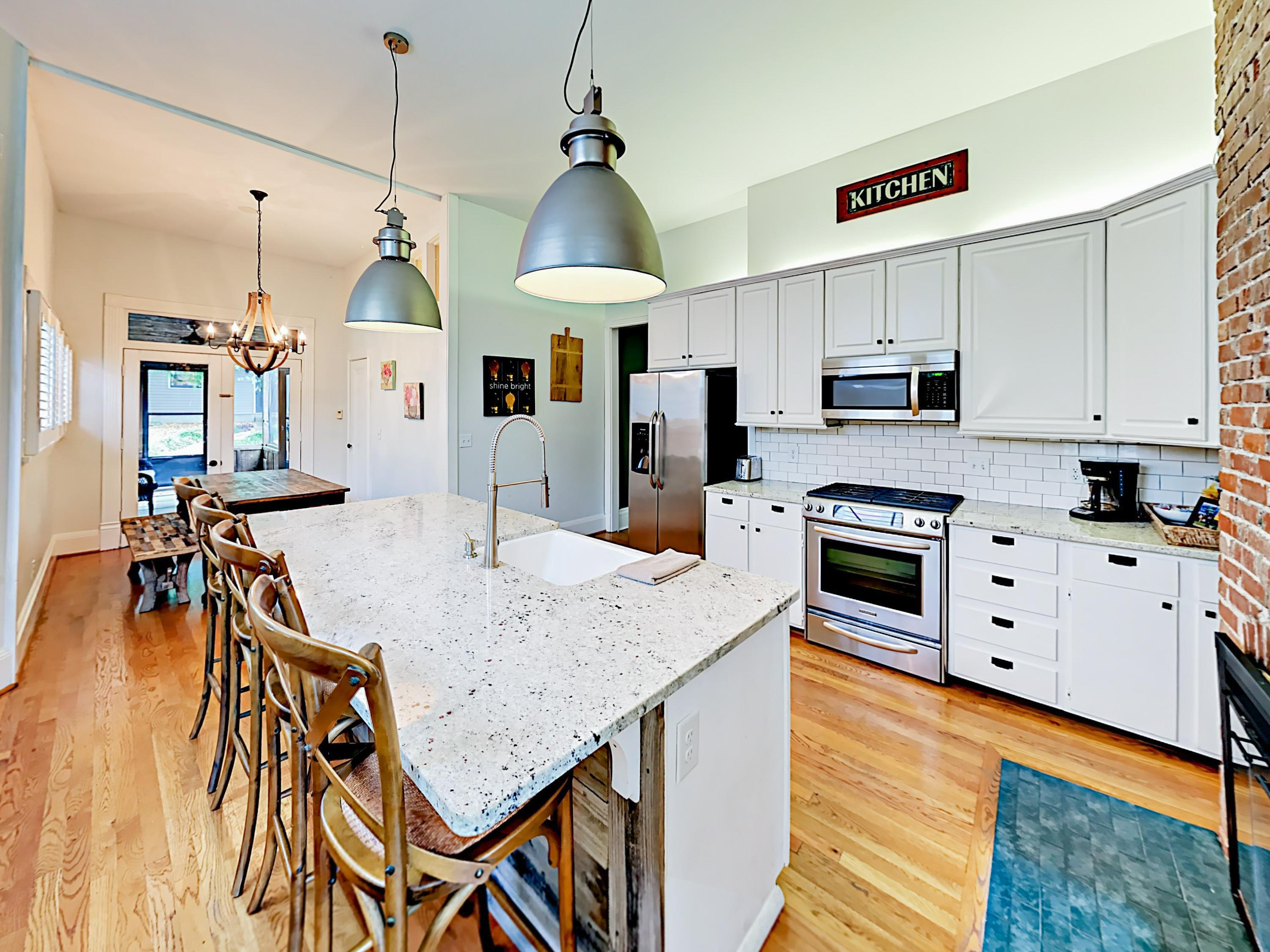 The kitchen features exquisite granite countertops and stainless steel appliances.