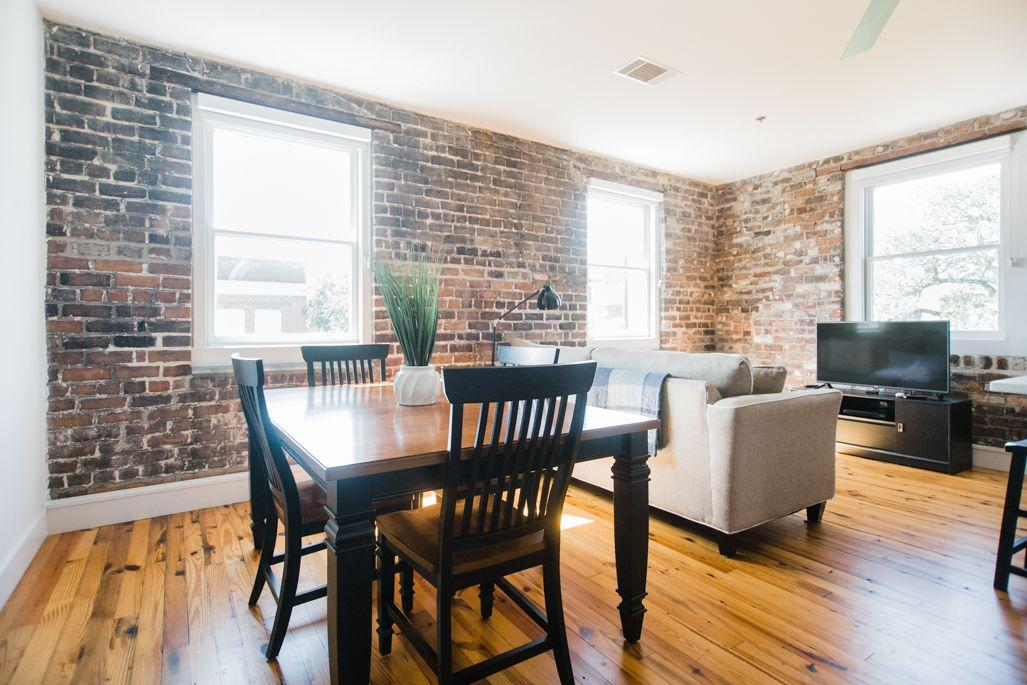 Exposed brick is carried throughout each room.