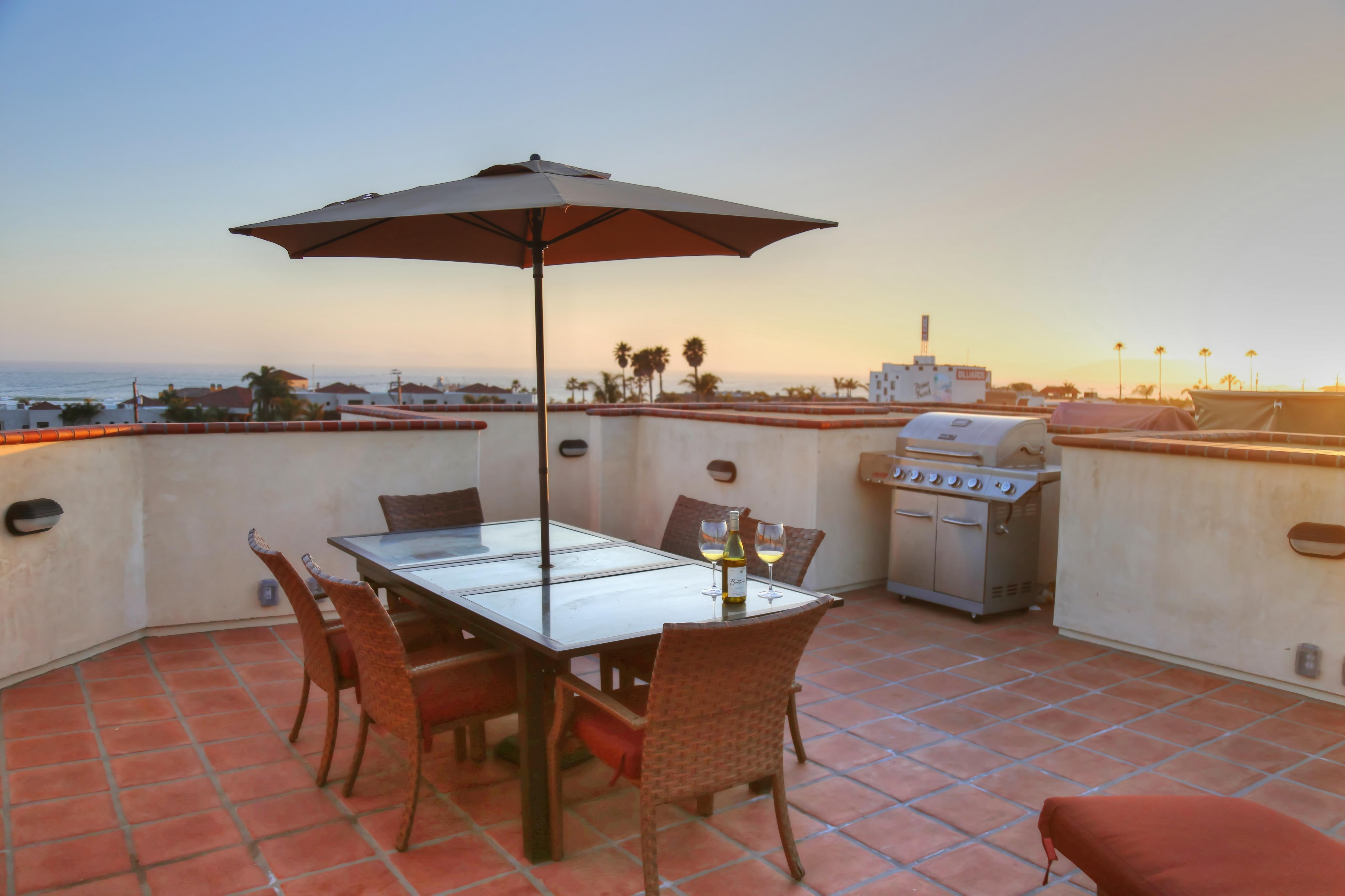 Rooftop living area with dining for six (6), two lounge chairs, and built-in gas BBQ grill. Views of ocean, mountains and downtown Pismo Beach are breath taking.