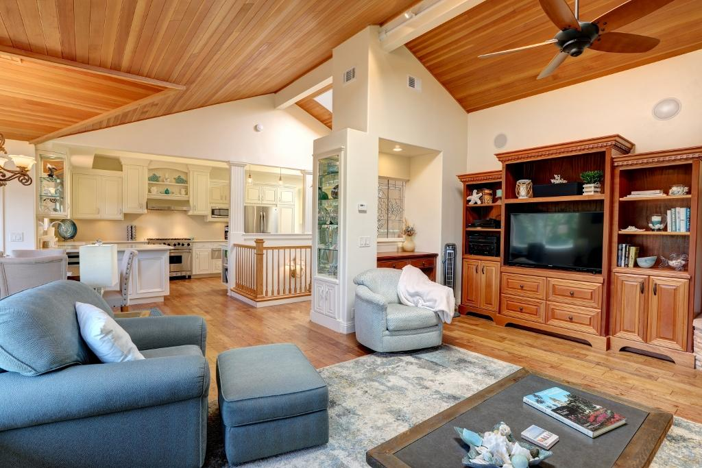 Homeowner has used neutral color palette and beach decor throughout the home. Open living room, dining and kitchen. Hardwood floors throughout primary living areas and billiard room.