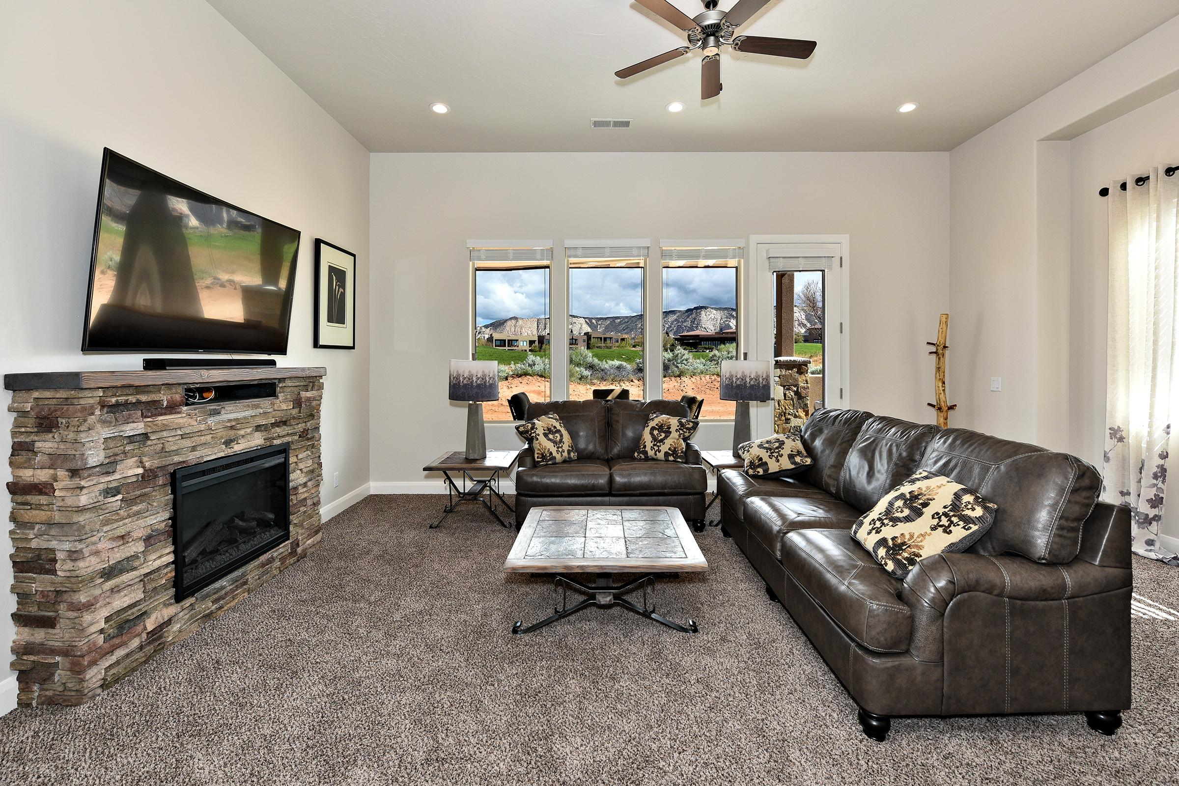 The living room has a beautiful view of The Ledges Golf Course.