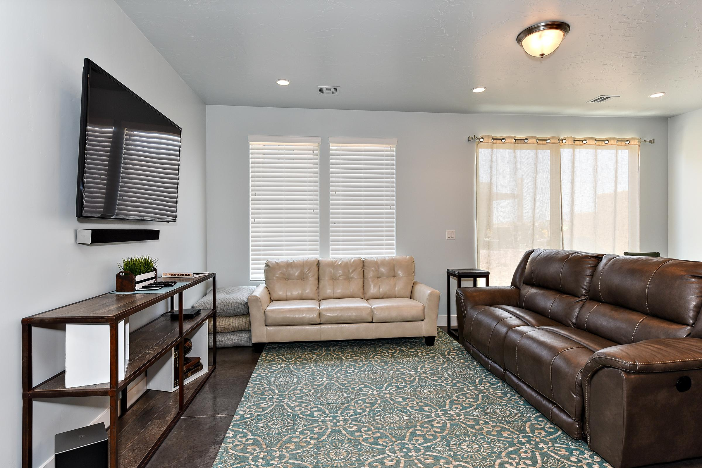 The Living Room is located adjacent to the Dining Room and is the perfect place to relax and watch your favorite movie or TV program.