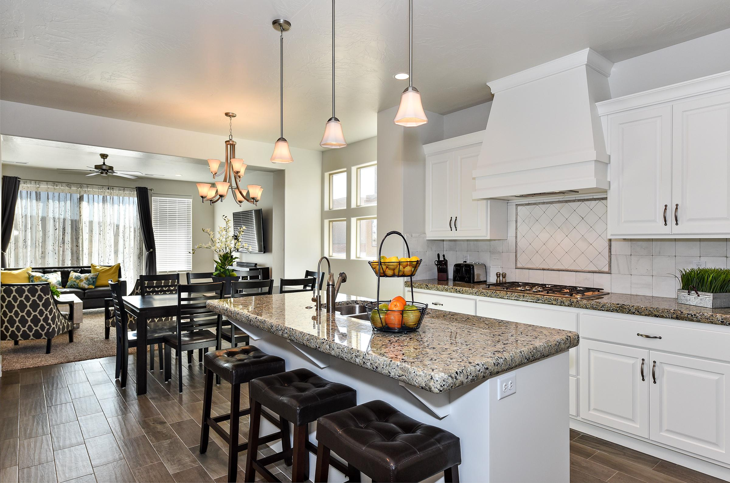 The Kitchen Island comfortably seats 3 adults and creates a great space for serving and preparing meals.