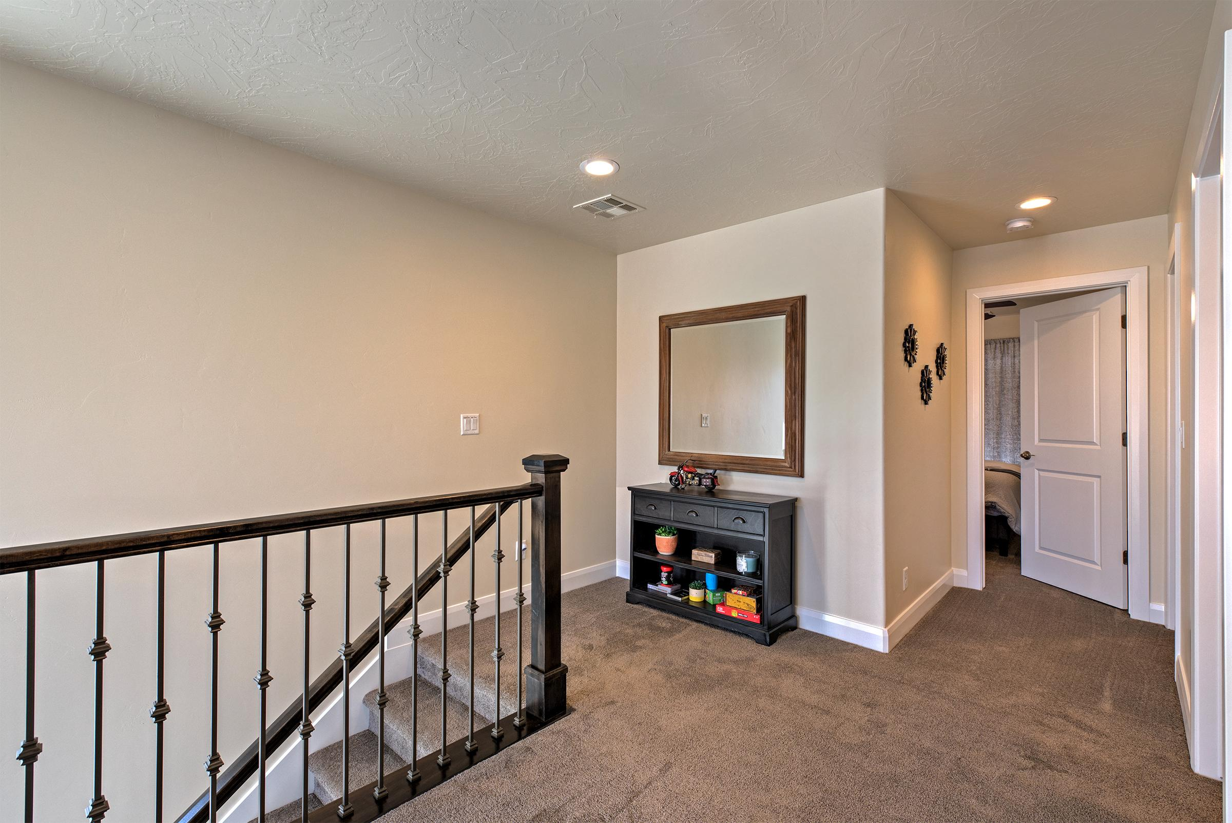 The Upstairs Landing leads to the two upstairs bedrooms, family room, and front patio deck.