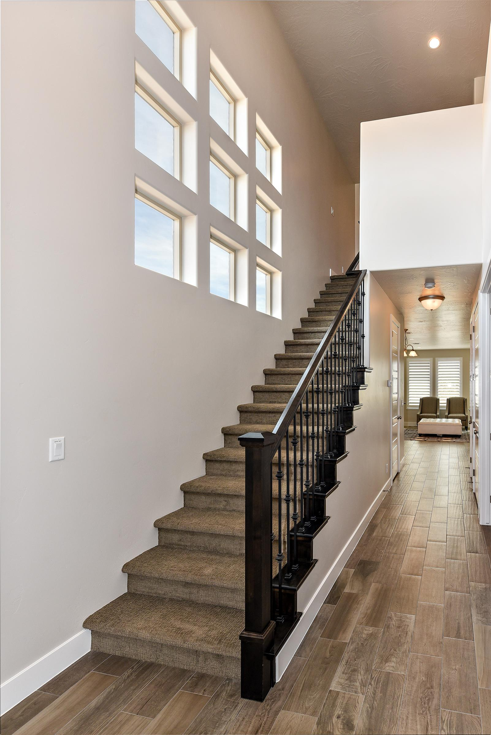 The Main Hallway leads to the Master Bedroom, Kitchen, Dining Room, and Living Room.  The Stairway leads to the Upstairs Bedrooms and Family Room