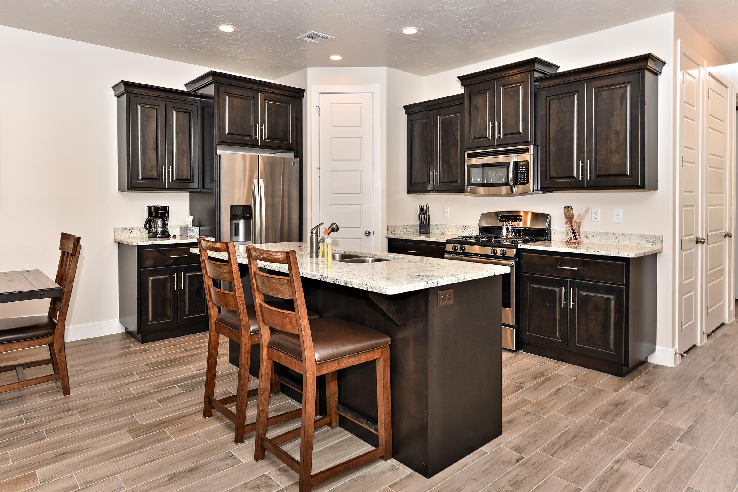 The kitchen is fully stocked with all the dishes, cookware, baking pans, and cutlery you will need for meal preparations and includes stainless steel appliances and granite counter tops.