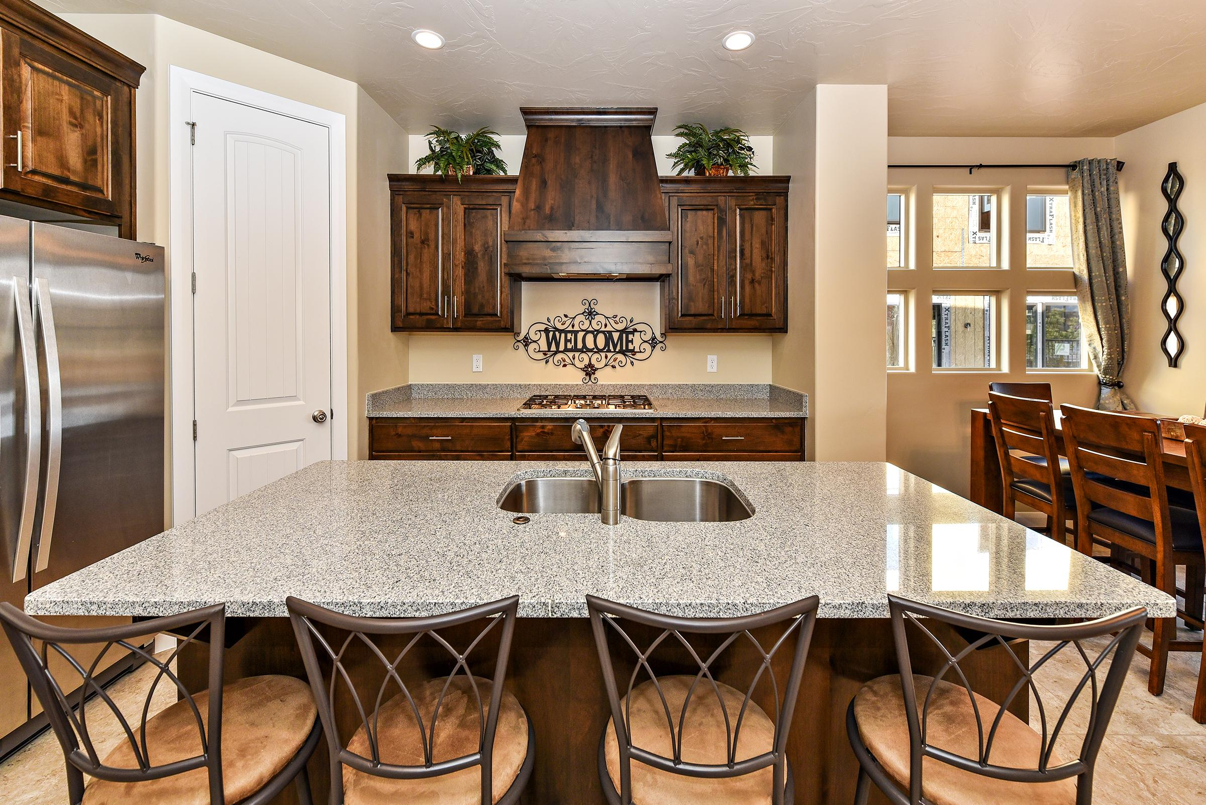The Kitchen Island comfortably seats 4 adults and creates a great space for serving and preparing meals.