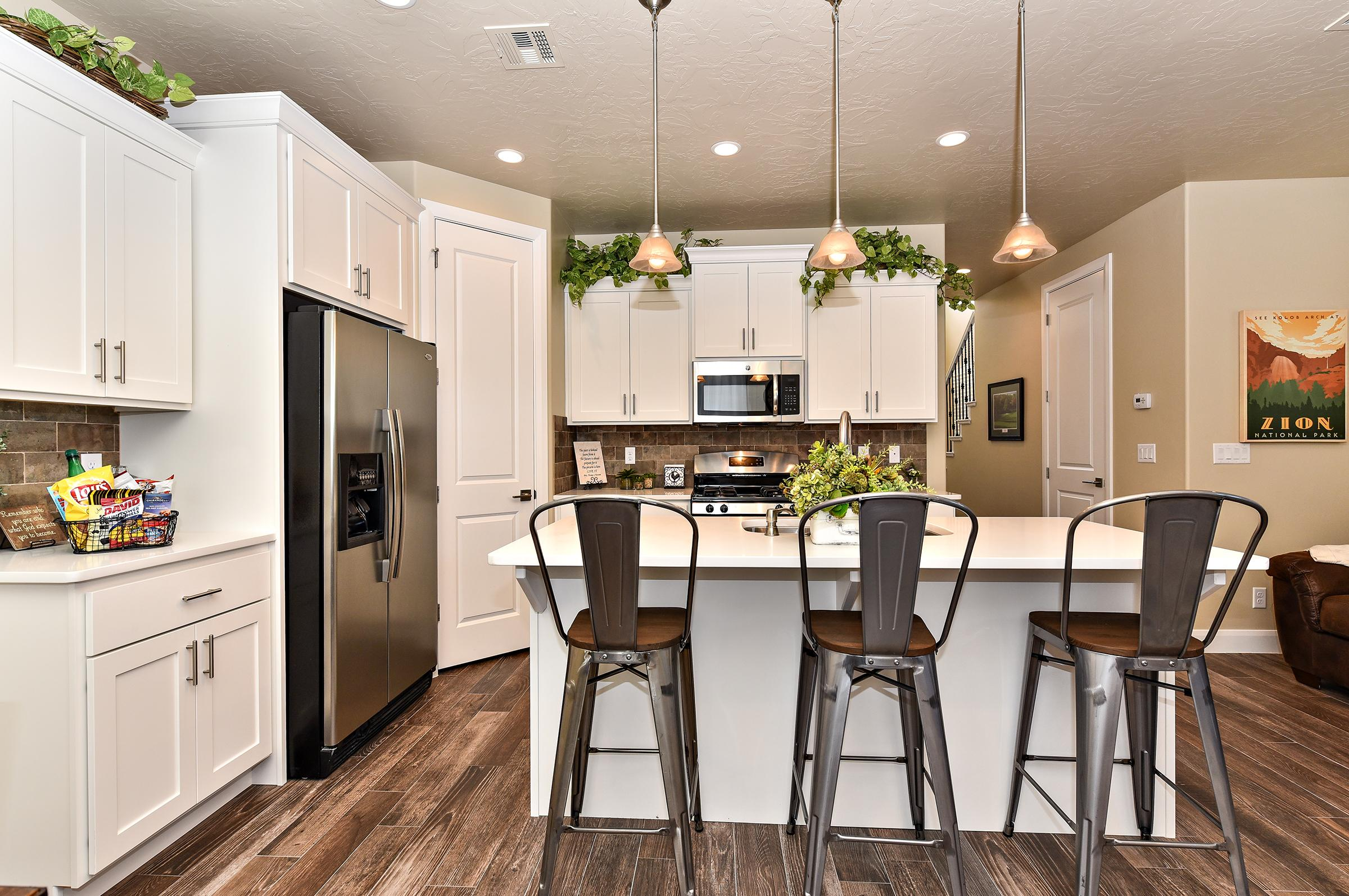 The Kitchen Island comfortably seats 3 adults and creates a great space for serving and preparing meals