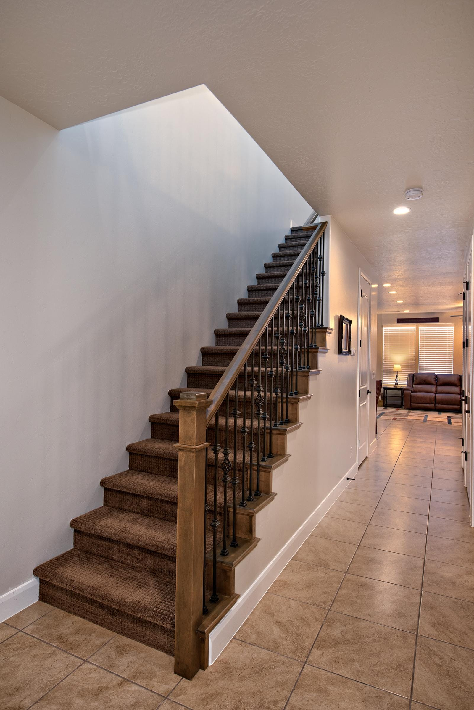 The Main Hallway leads to the Master Bedroom, Kitchen, Dining Room, and Living Room.  The Stairway leads to the Upstairs Bedrooms and Family Room.
