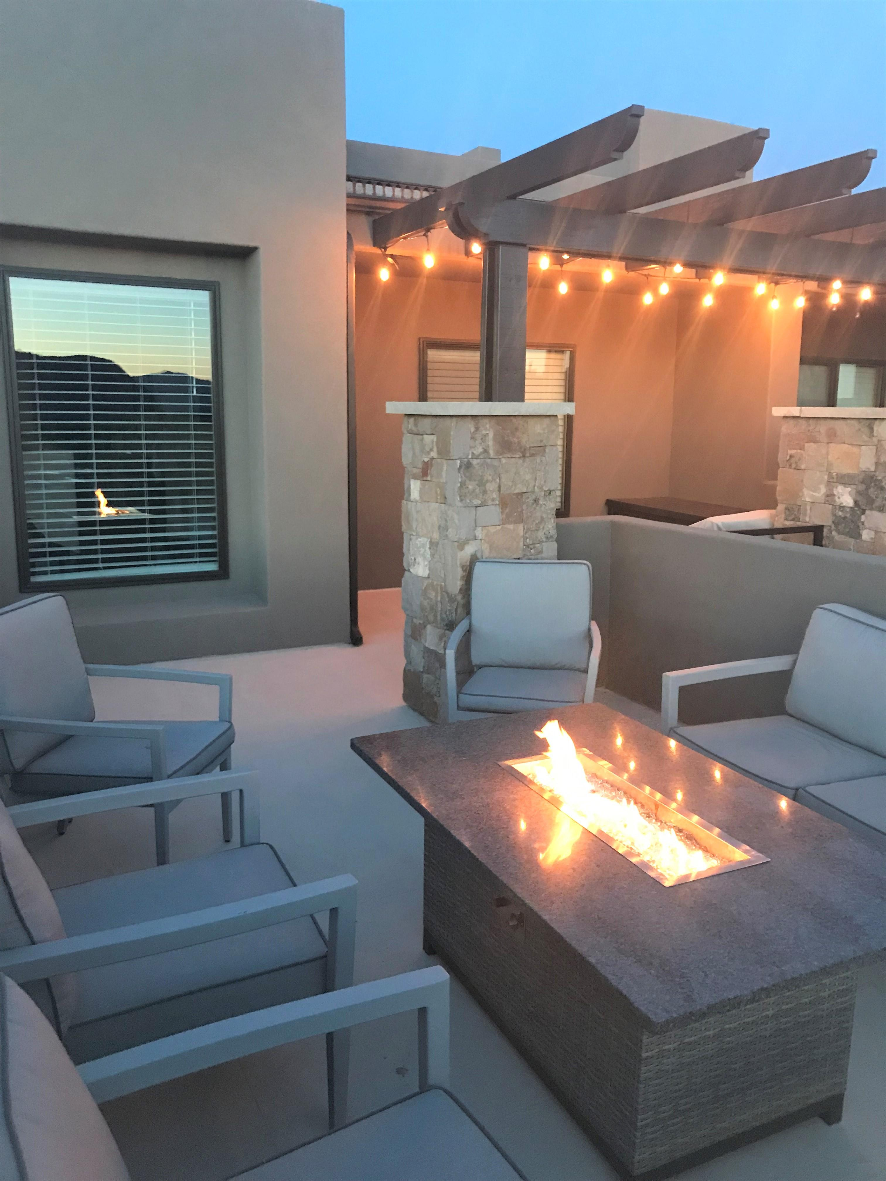 Enjoy a stunning sunset or sunrise from the front patio while sitting around our cozy outdoor firepit.