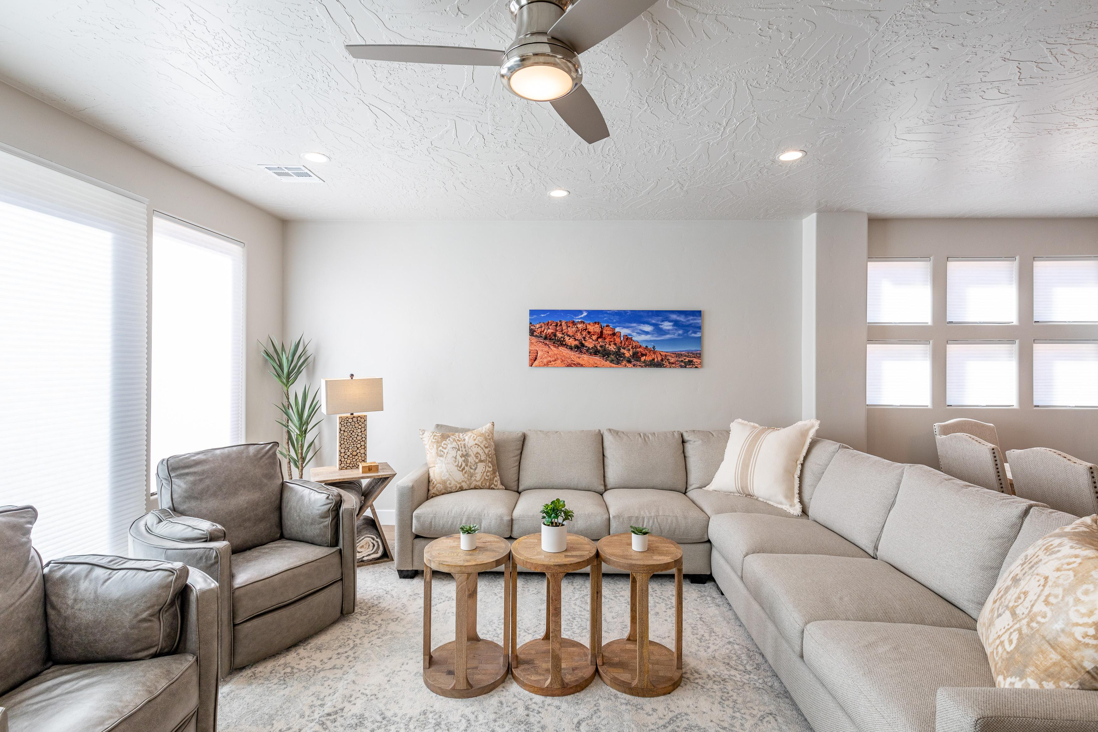 The living room is designed as an open floor plan and is a great gathering place for meals, games, or watching TV during your stay.