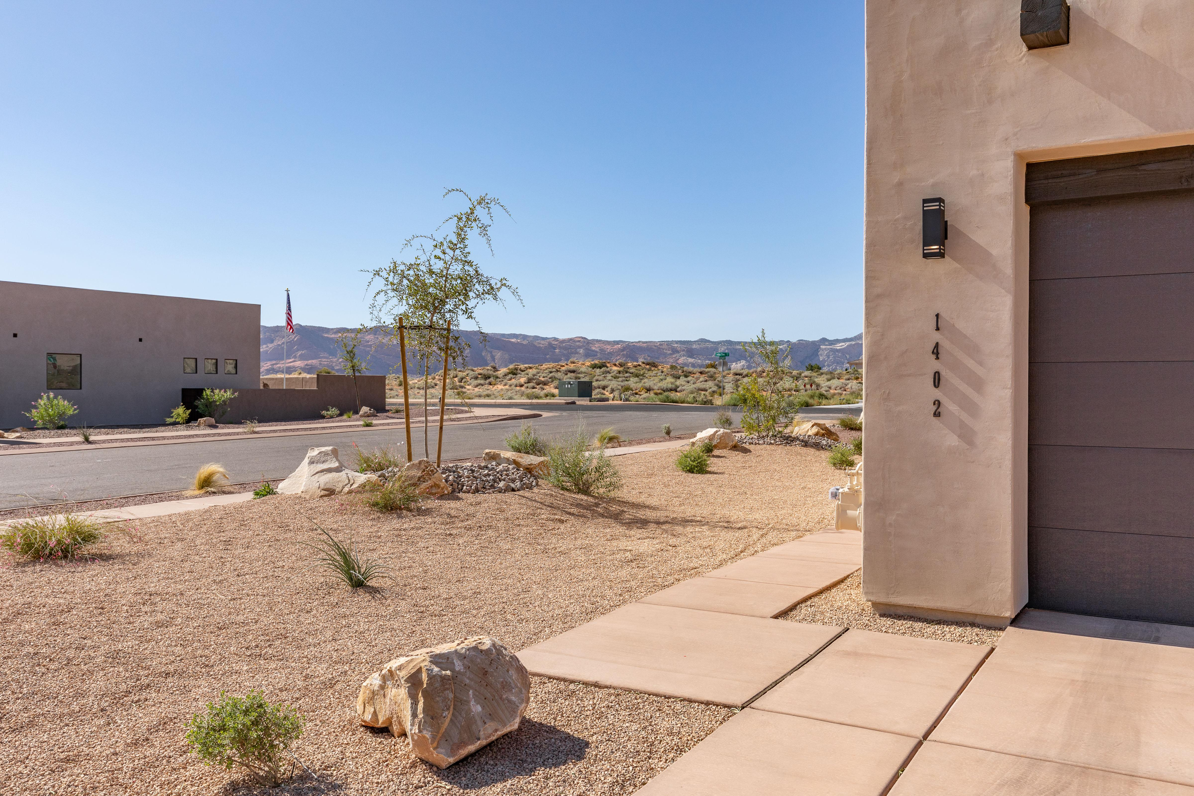 This home is located on the corner and has an amazing view of the red mountains