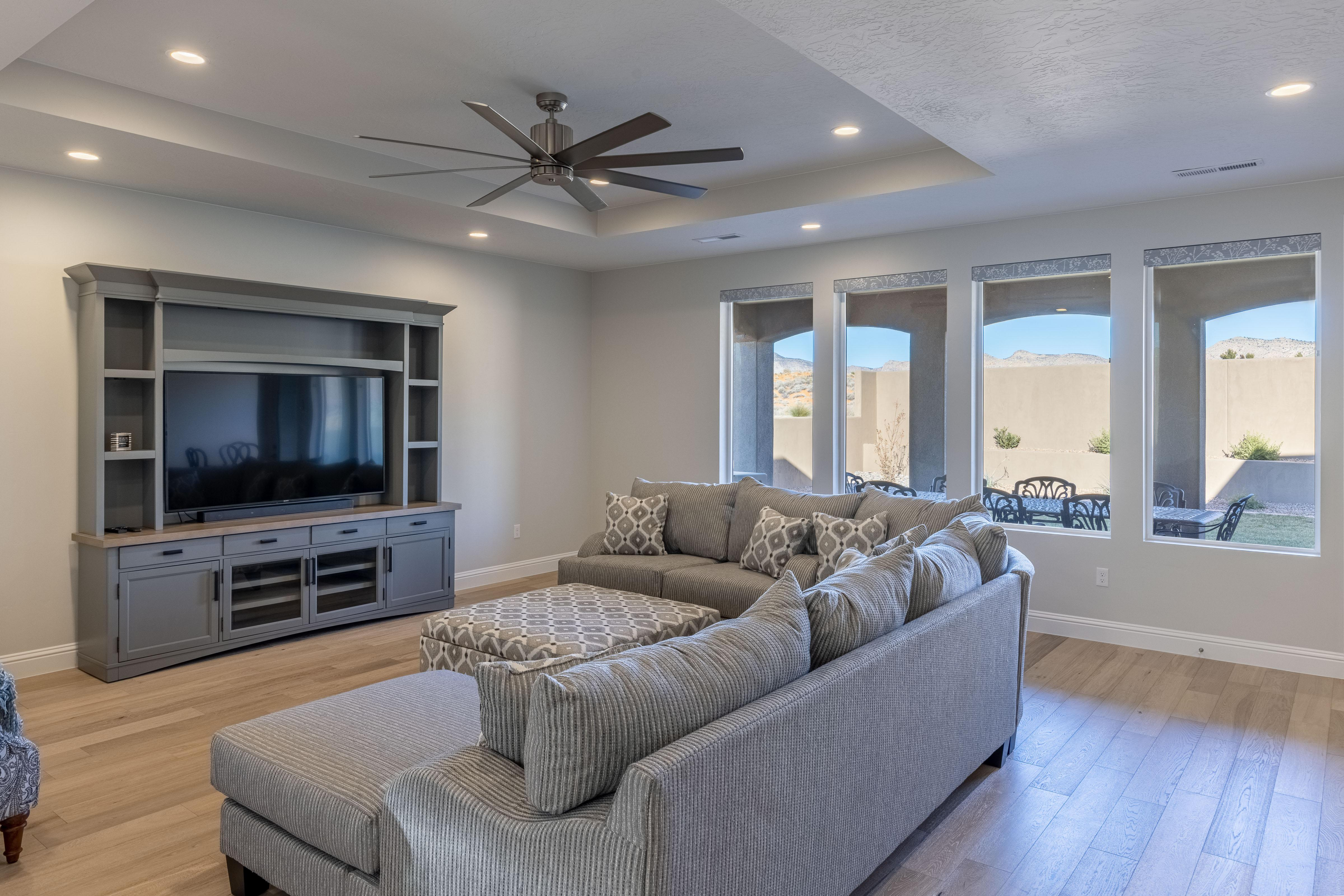 The living room is conveniently adjacent to the kitchen. There is also access to the back patio which has a BBQ grille suitable for all your favorite BBQ dishes.